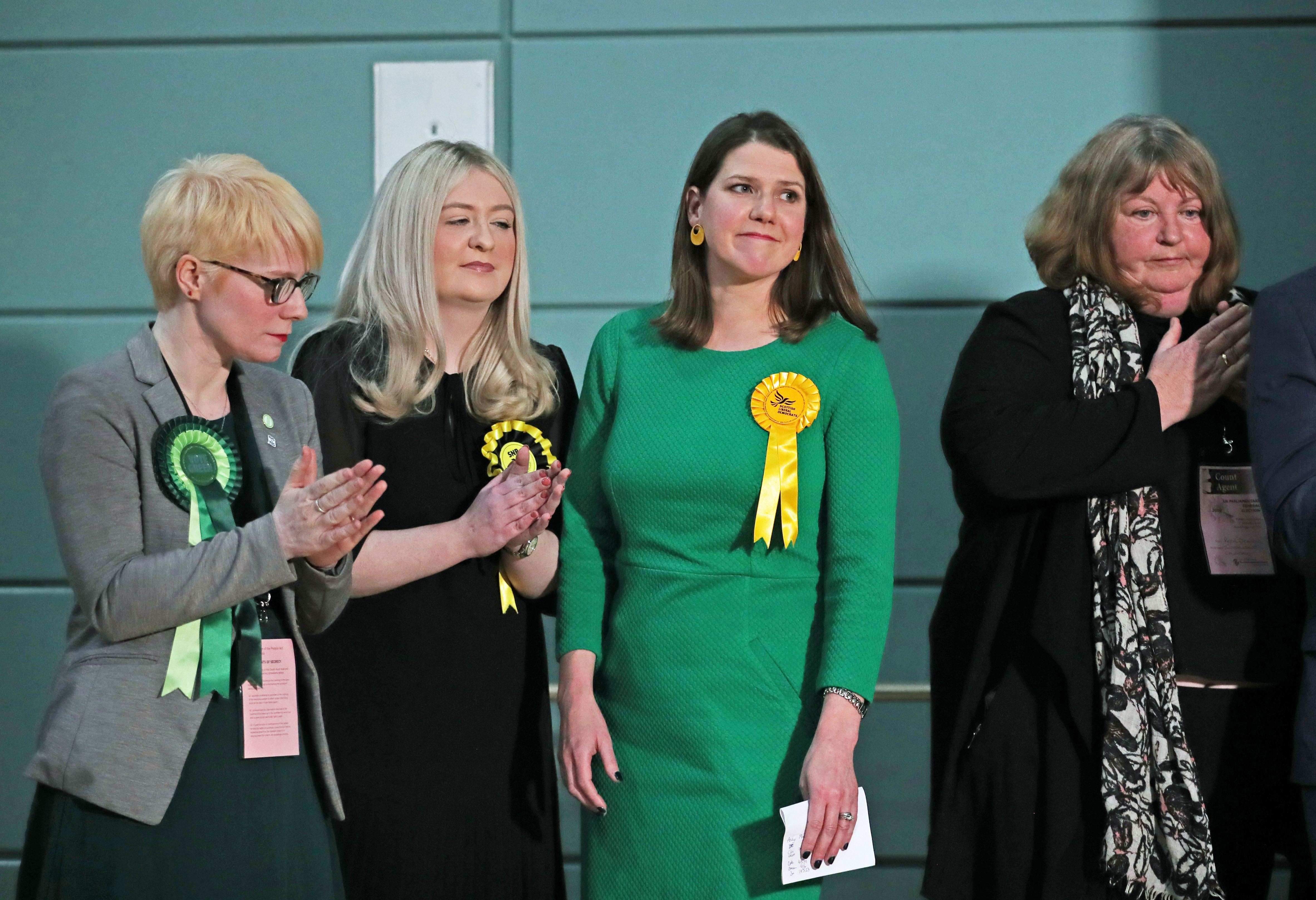 Lib Dem leader Jo Swinson (second right) reacts as she loses her East Dumbartonshire constituency, during the count at the Leisuredome, Bishopbriggs. (Photo by Jane Barlow/PA Images via Getty Images)