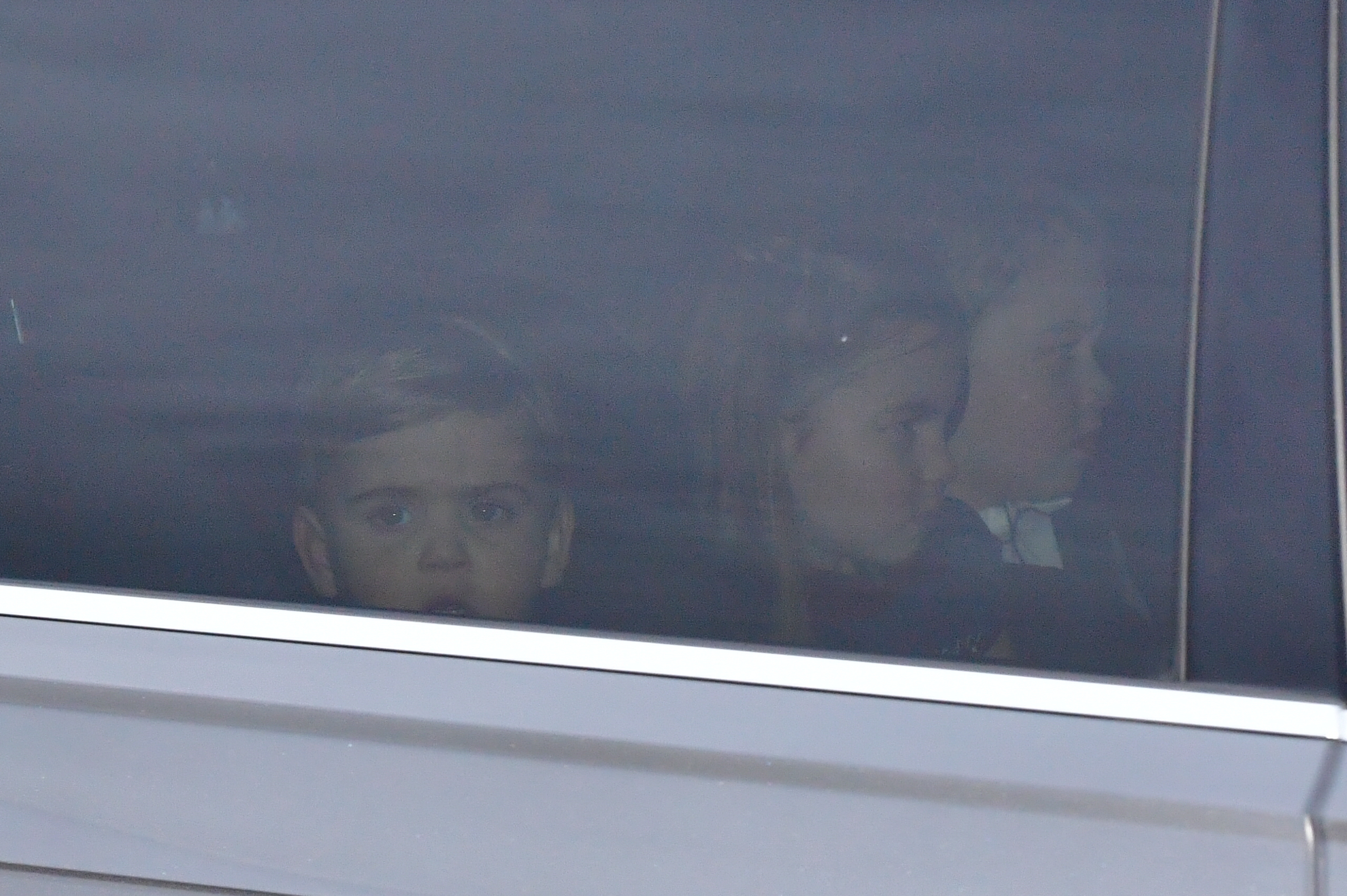 (left to right) Prince Louis, Princess Charlotte and Prince George leaving the Queen's Christmas lunch at Buckingham Palace, London.