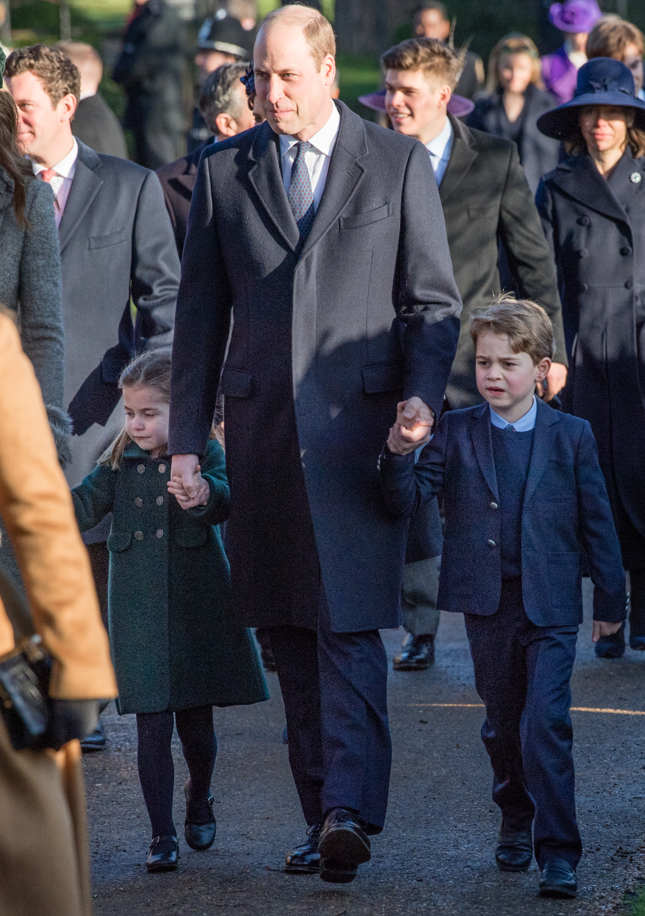 KING'S LYNN, ENGLAND - DECEMBER 25:  Prince William, Duke of Cambridge, Prince George of Cambridge and Princess Charlotte of Cambridge attend the Christmas Day Church service at Church of St Mary Magdalene on the Sandringham estate on December 25, 2019 in King's Lynn, United Kingdom. (Photo by Pool/Samir Hussein/WireImage)