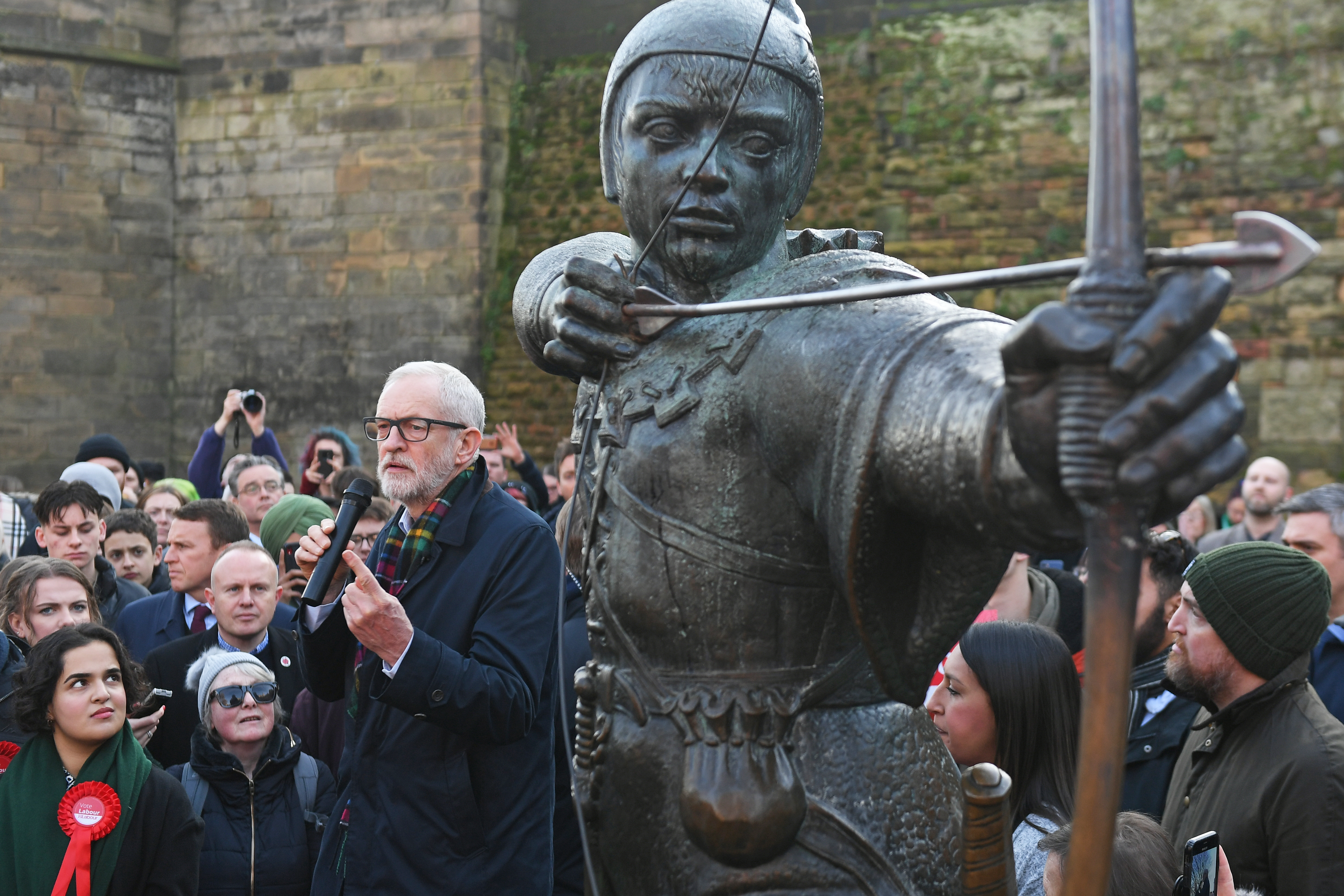 Labour leader Jeremy Corbyn speaks to a crowd of supporters next to a statue of Robin Hood in Nottingham, while on the General Election campaign trail.