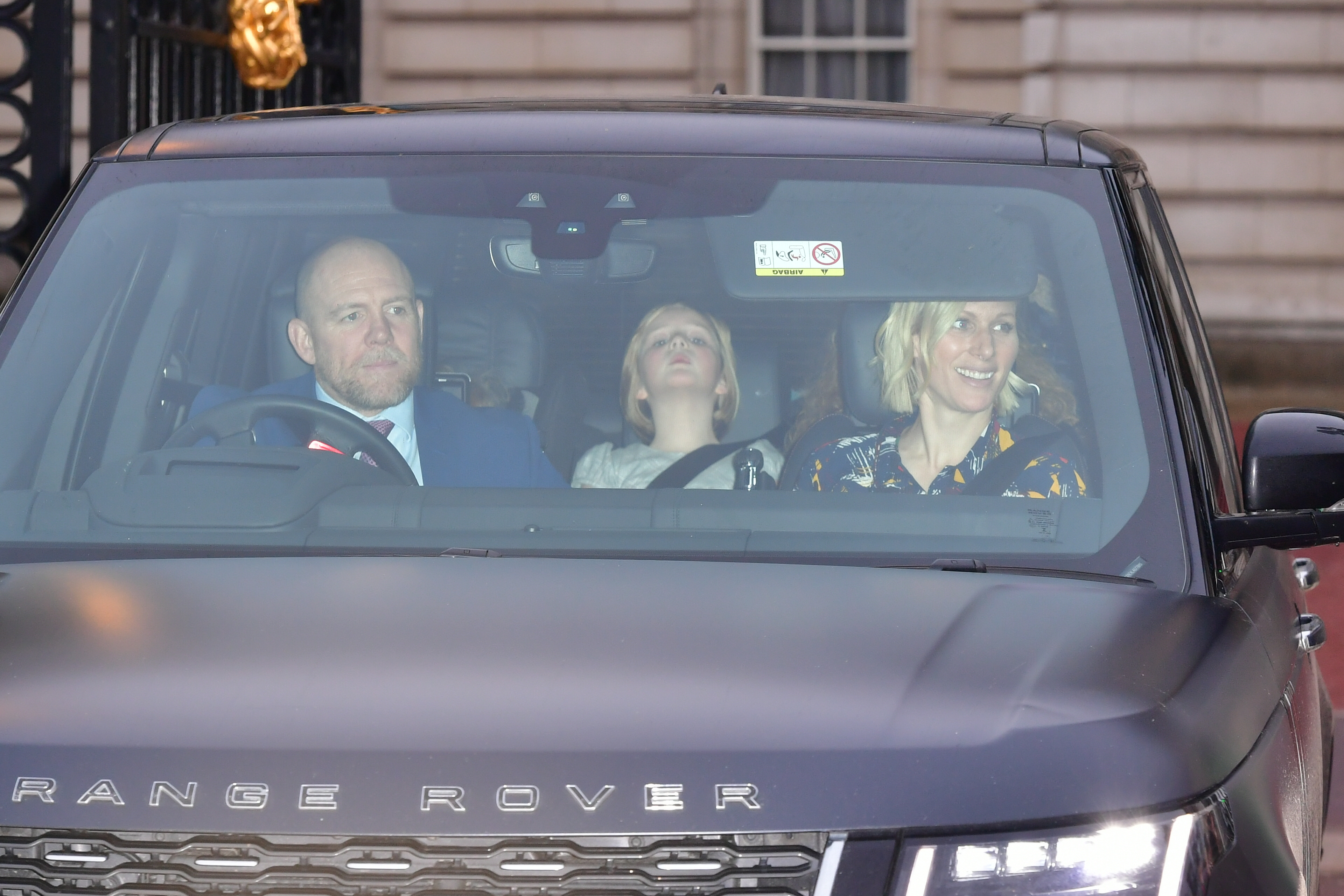 Mike Tindall and Zara Tindall, with daughter Mia Grace, leaving the Queen's Christmas lunch at Buckingham Palace, London.