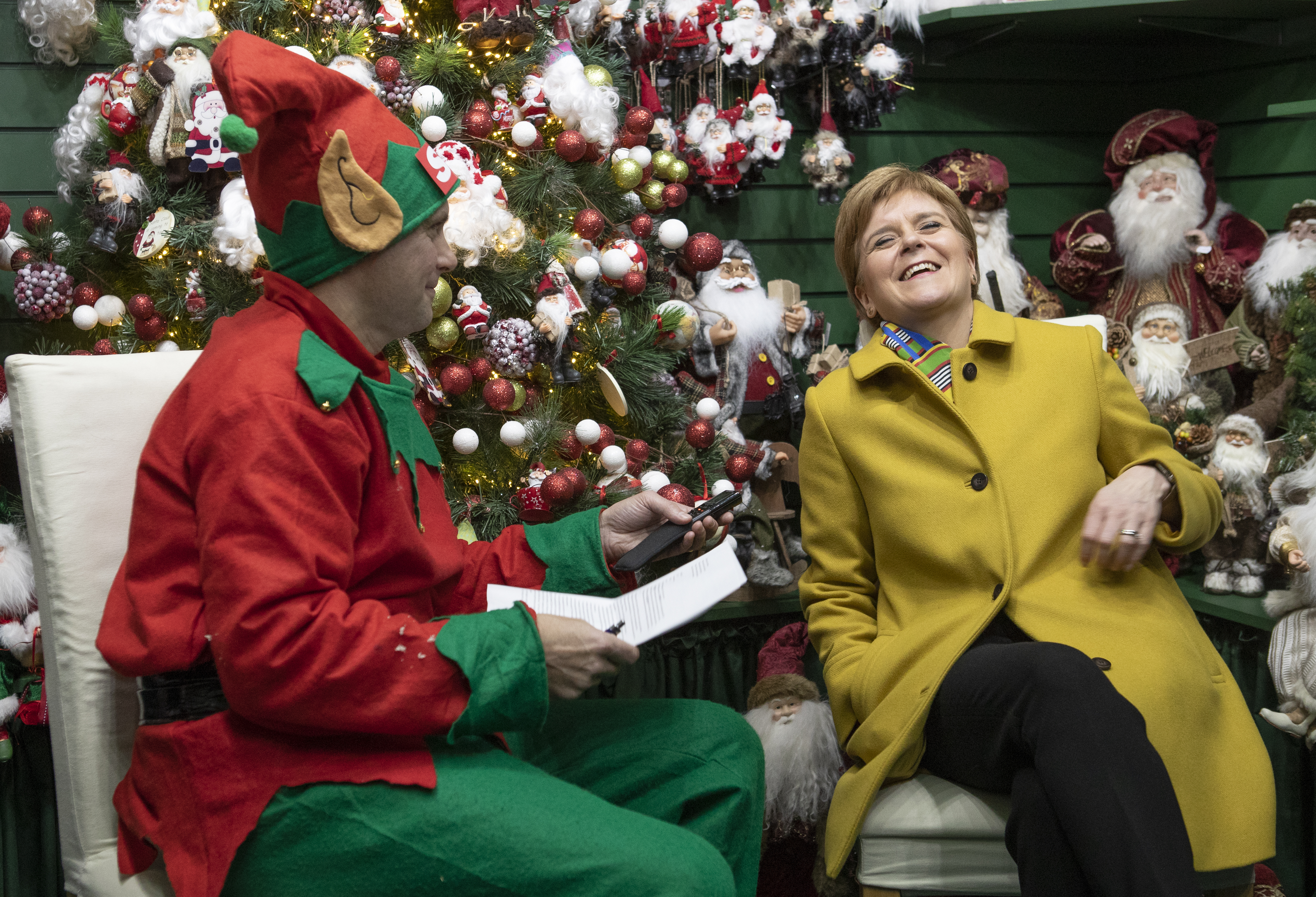 SNP leader Nicola Sturgeon is interviewed by a journalist dressed as a Christmas elf in the Nutcracker Christmas Village shop during a visit to Crieff Visitors Centre, Crieff, on the General Election campaign trail.