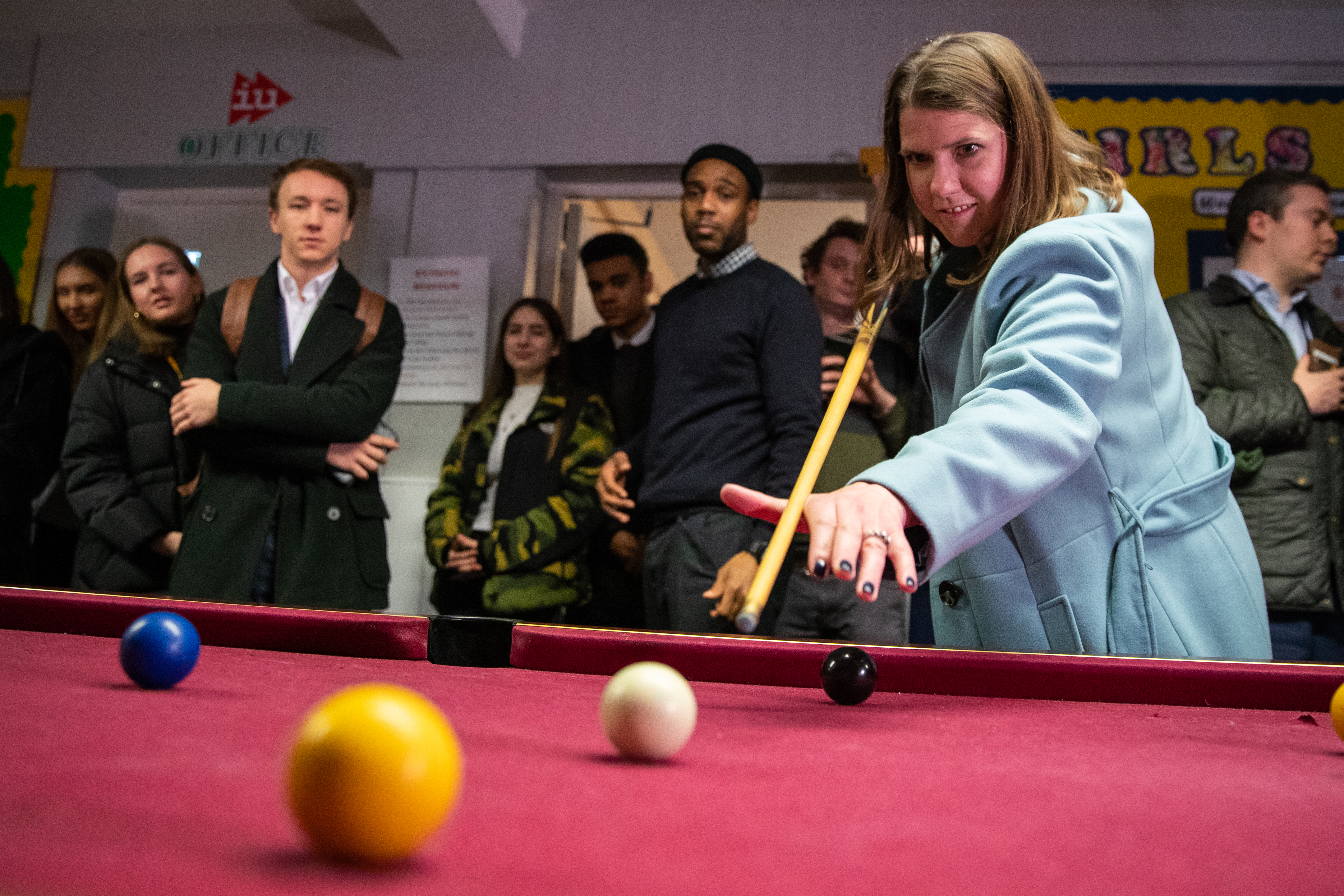 Liberal Democrat leader Jo Swinson plays pool during a visit to Knights Youth Centre in London, while on the General Election campaign trail.