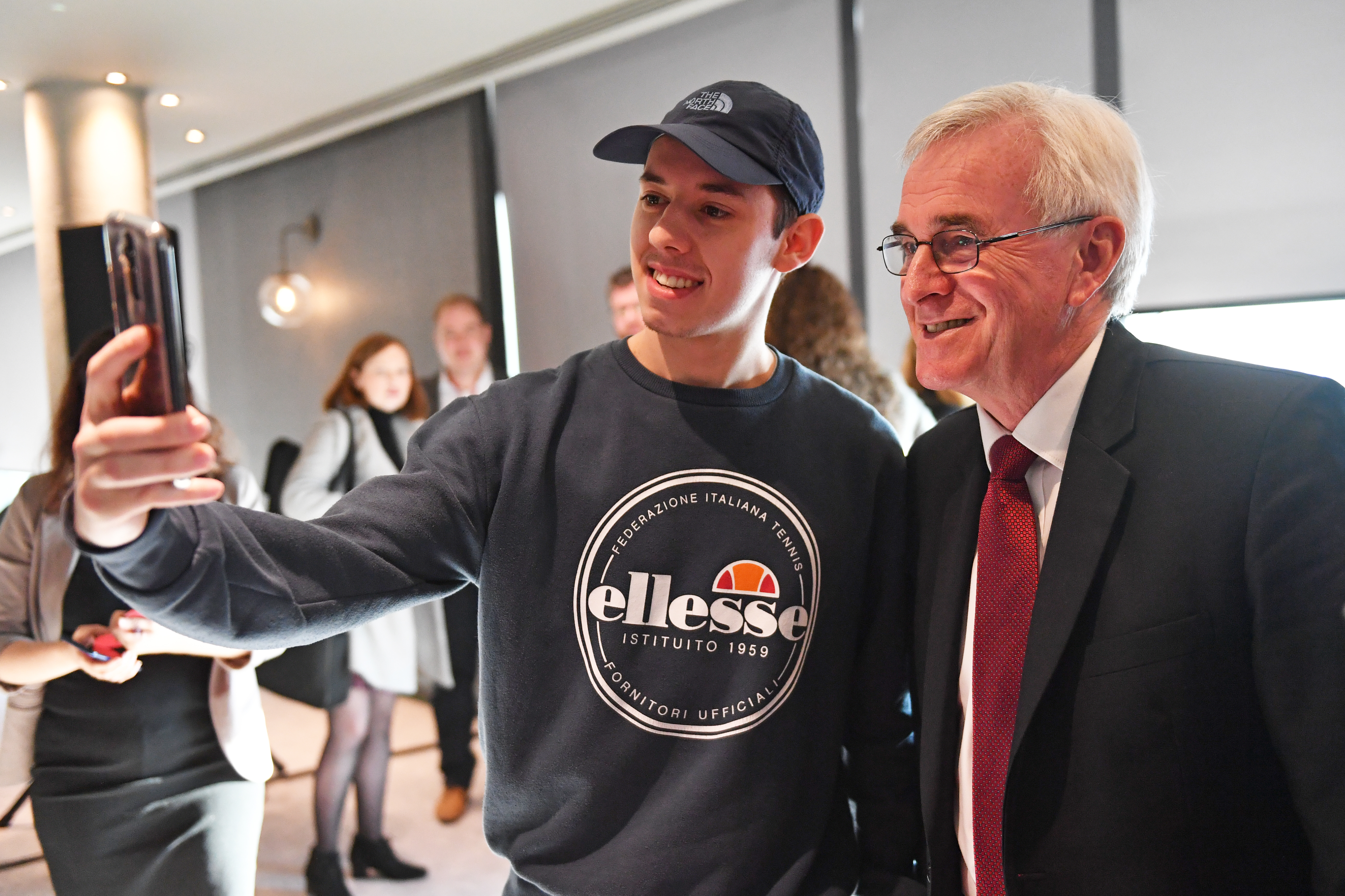 Shadow chancellor John McDonnell takes a photo with a supporter at a campaign event in Birmingham, whilst on the General Election campaign trail.