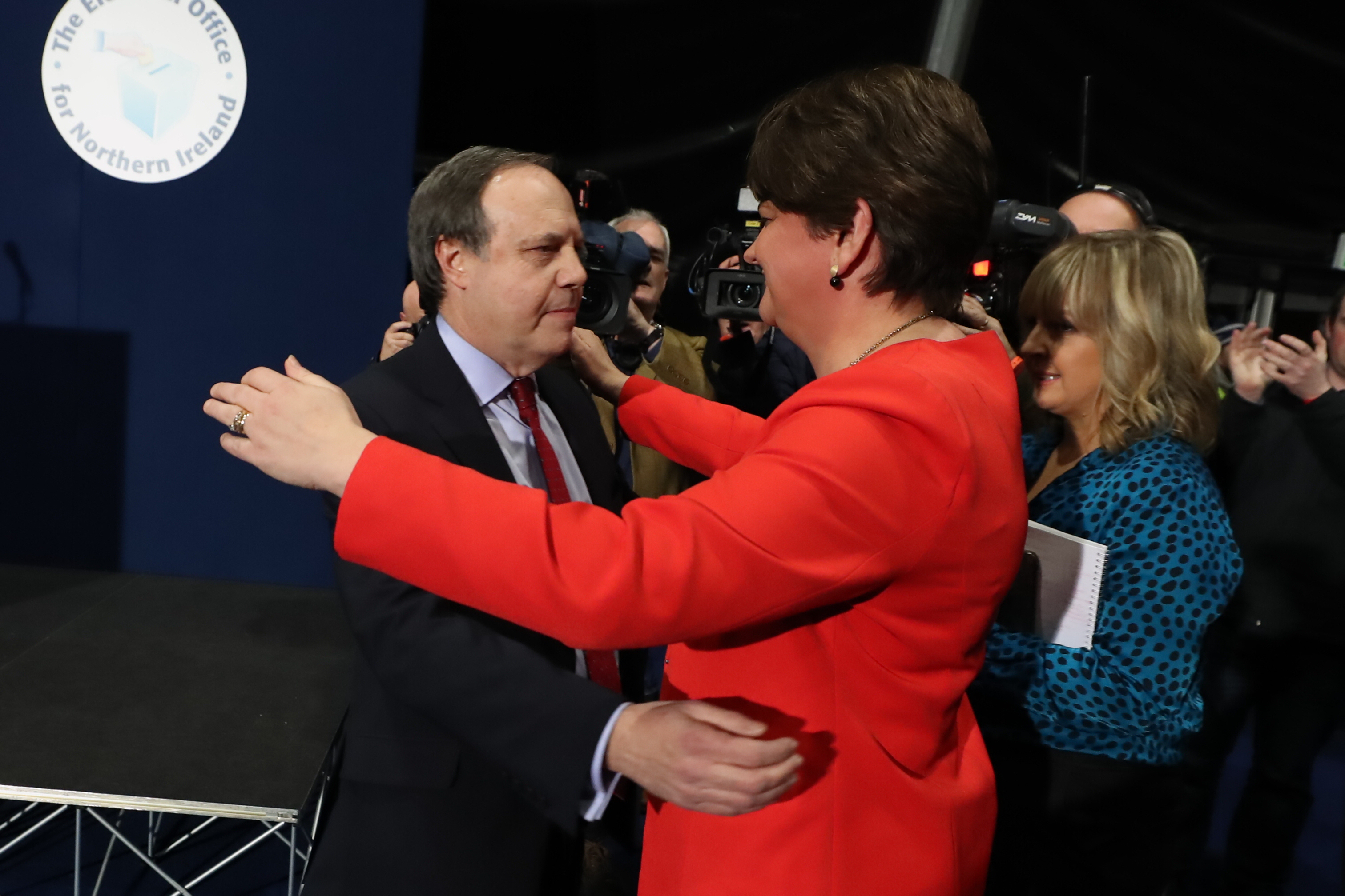 The DUP's Nigel Dodds is embraced by leader Arlene Foster after losing the Belfast North seat at the Titanic exhibition centre, Belfast, for the 2019 General Election. (Photo by Liam McBurney/PA Images via Getty Images)