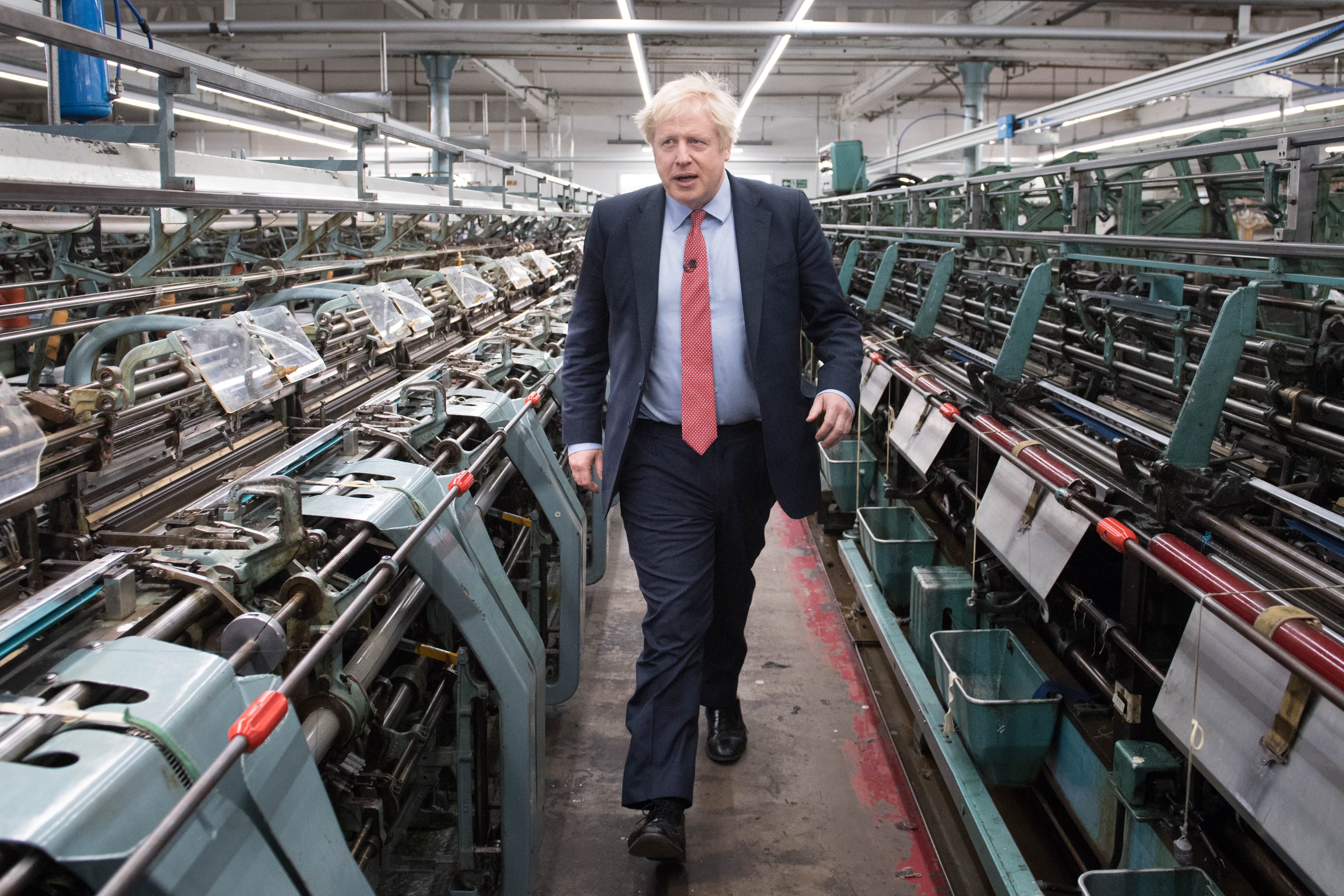 Prime Minister Boris Johnson during a visit to the John Smedley Mill, while election campaigning in Matlock, Derbyshire.