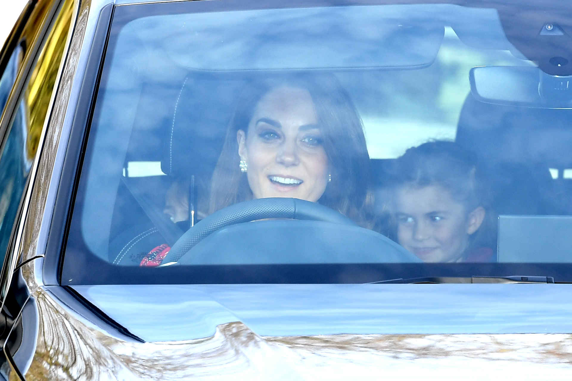 The Duchess  of Cambridge and Princess Charlotte arriving at the Queen's Christmas Lunch, Buckingham Palace, London.