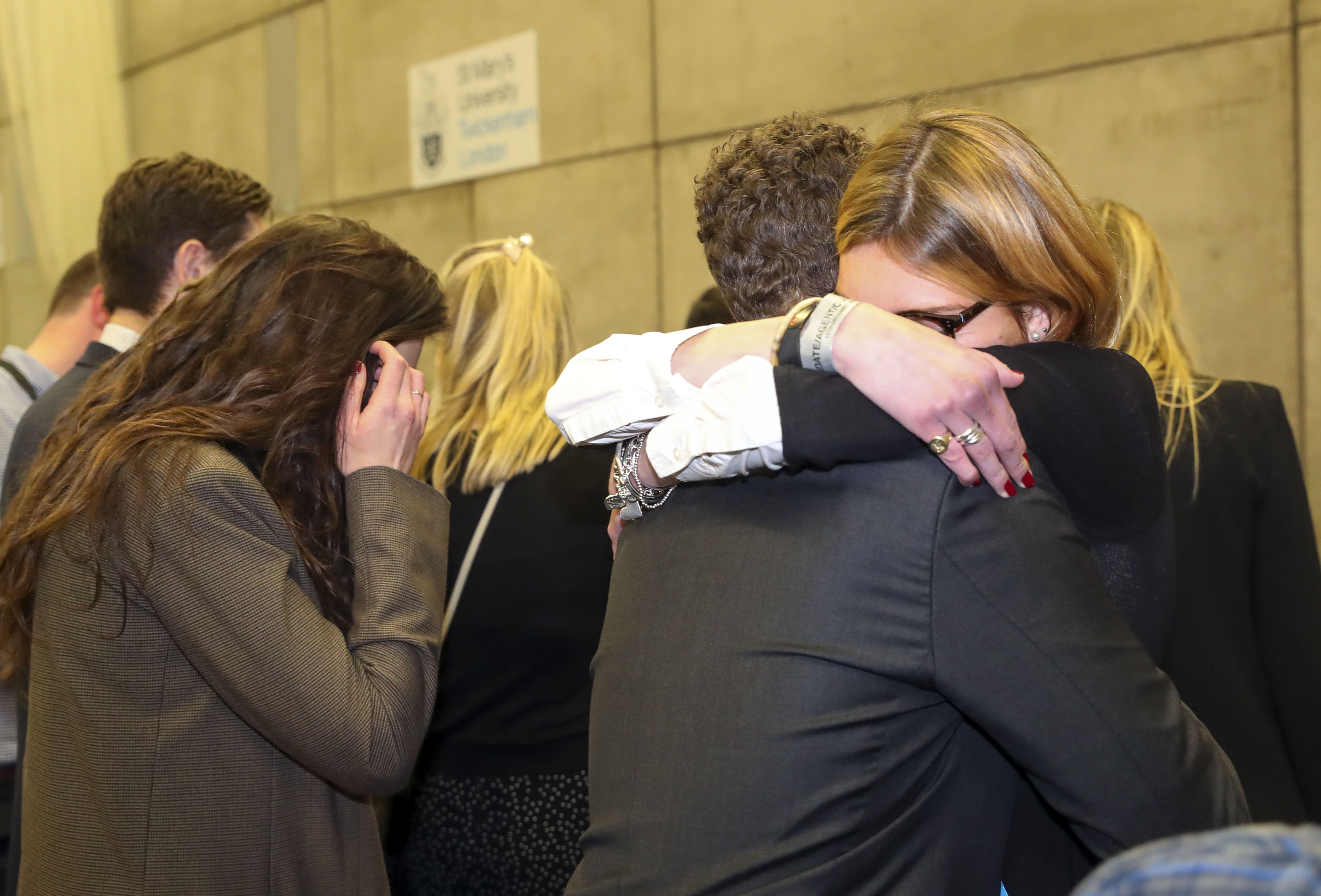 Supporters of Conservative candidate Zac Goldsmith hug after hearing at St Mary's University, in Strawberry Hill, Twickenham, that he had lost his Richmond Park seat in the 2019 General Election. (Photo by Steve Parsons/PA Images via Getty Images)