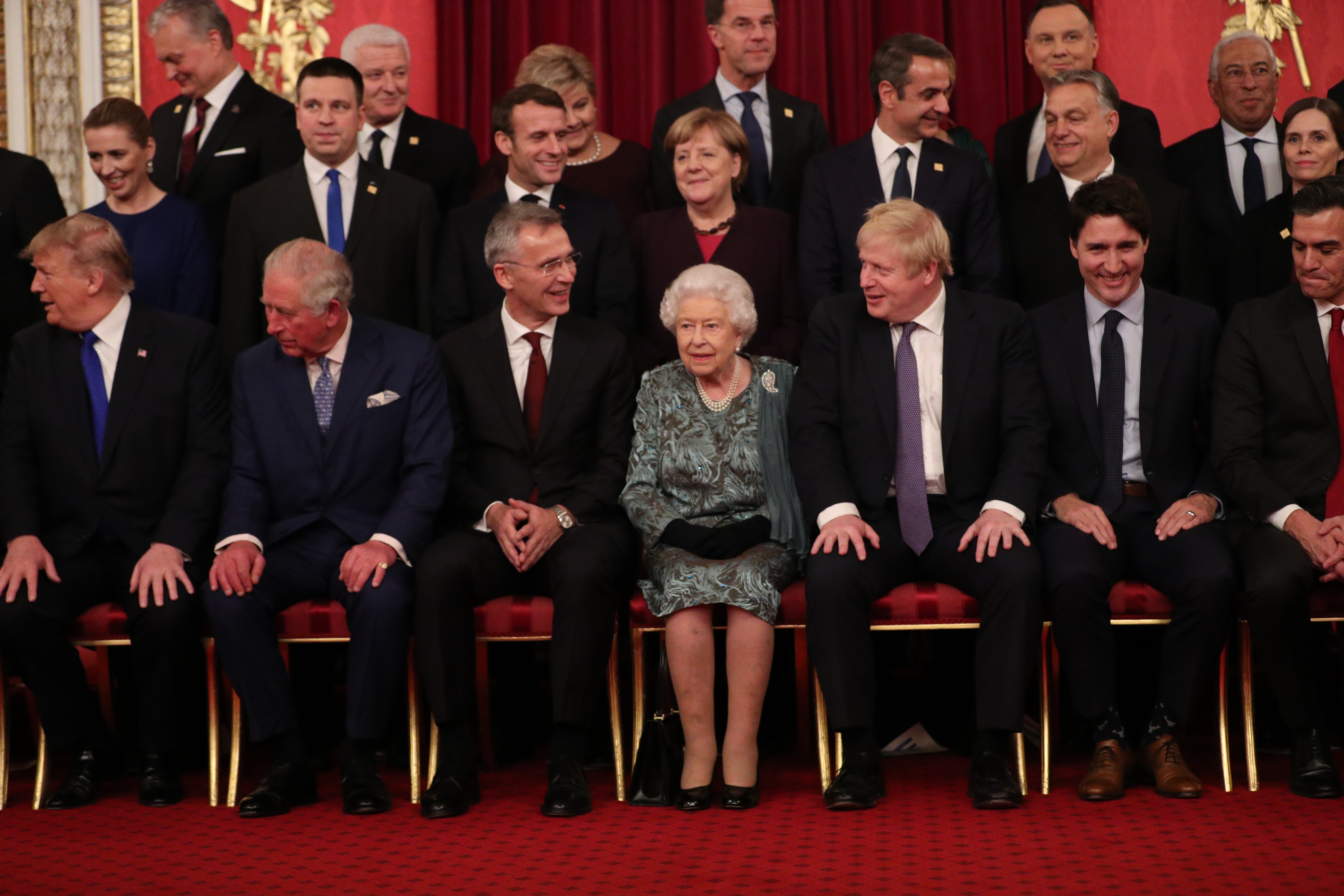 Queen Elizabeth II and Prime Minister Boris Johnson joins other Nato leaders for a group photograph Chancellor of Germany, Angela Merkel, talks to Queen Elizabeth II during a reception at Buckingham Palace, London, as they gathered to mark 70 years of the alliance.