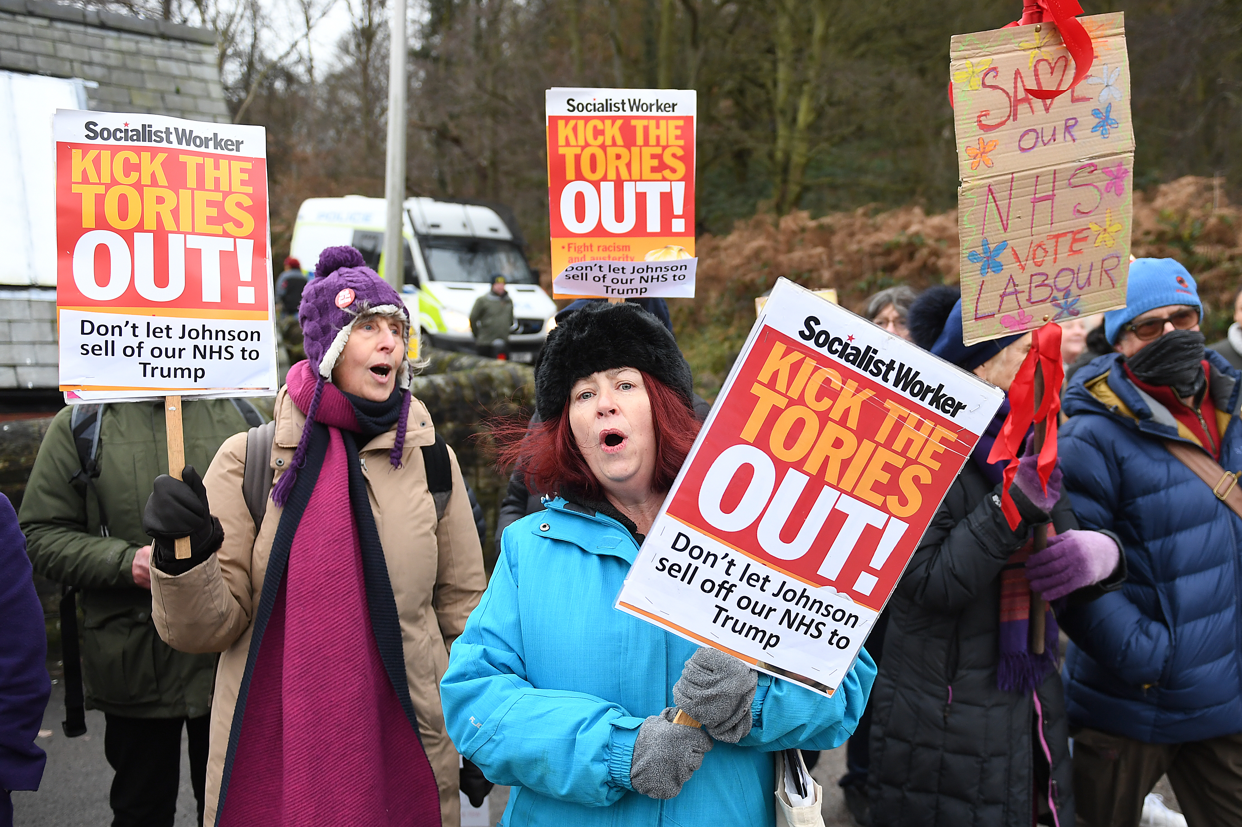 People protesting as Prime Minister Boris Johnson visits the John Smedley Mill Shop, while election campaigning in Matlock.