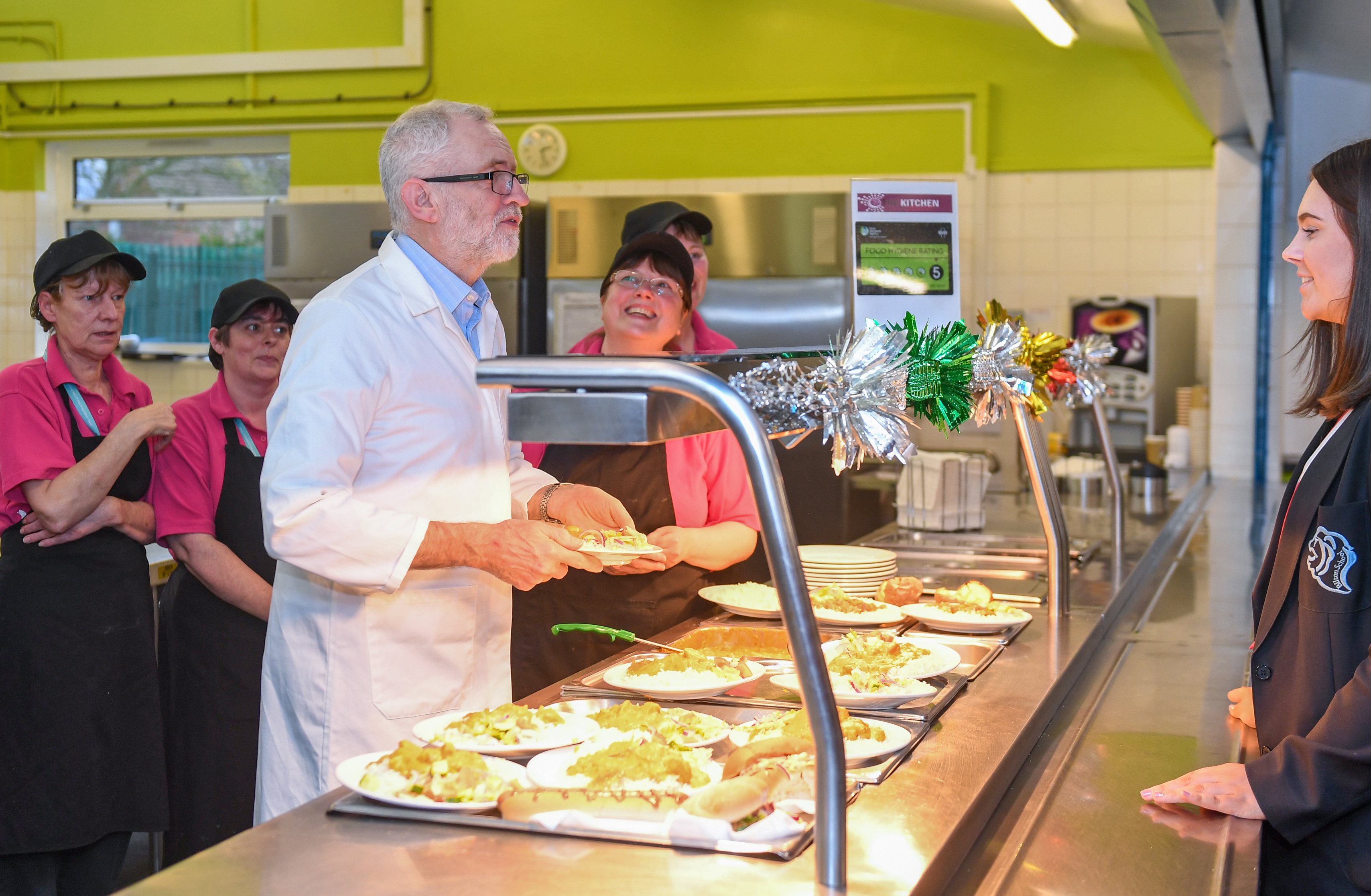 Labour leader Jeremy Corbyn serves students and teachers their school dinners at Bilton High School in Rugby, while on the General Election campaign trail.