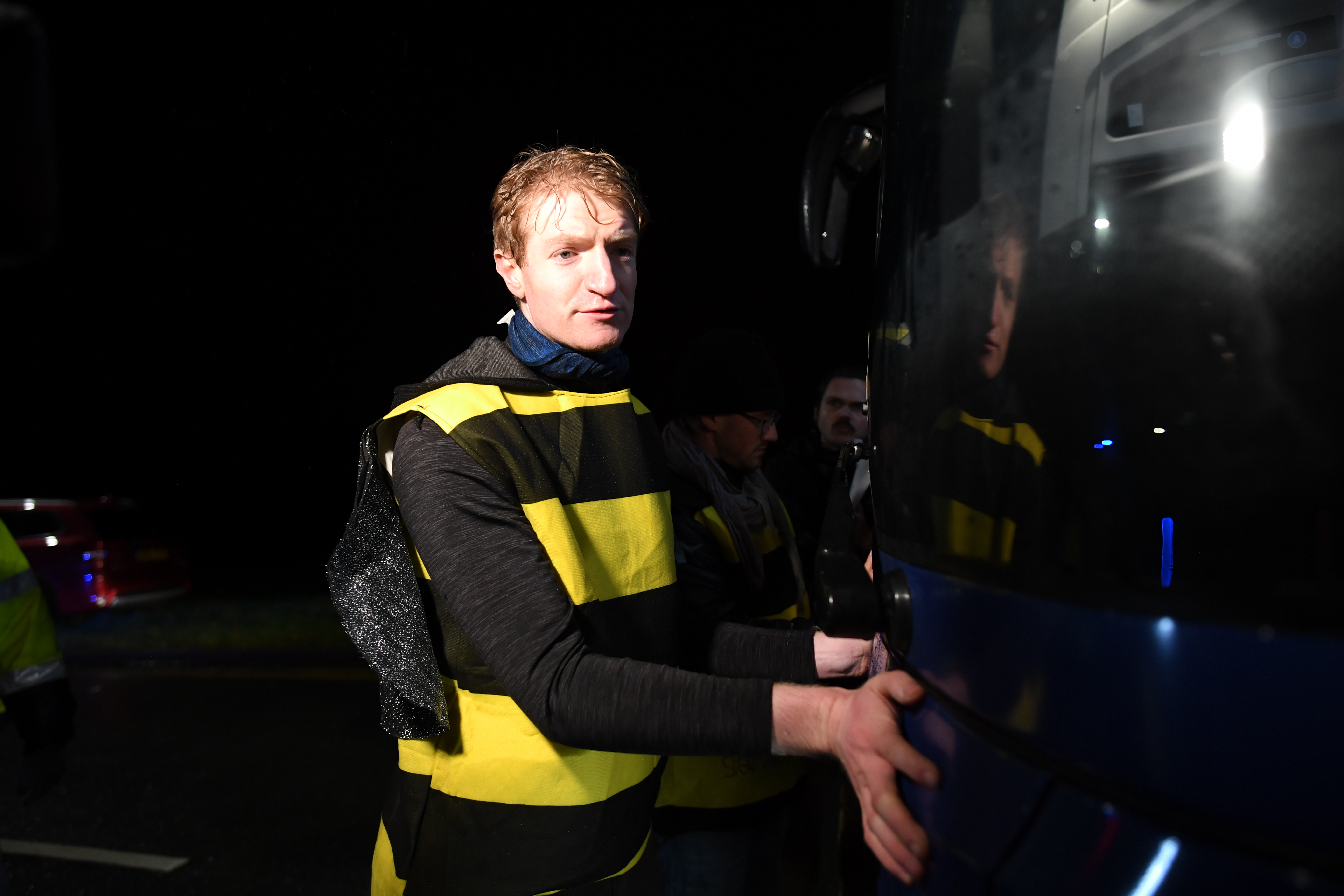 Extinction Rebellion protesters dressed as bees glue themselves to the Conservative Party campaign bus as Prime Minister Boris Johnson visits the JCB cab manufacturing centre in Uttoxeter, while on the General Election campaign trail.