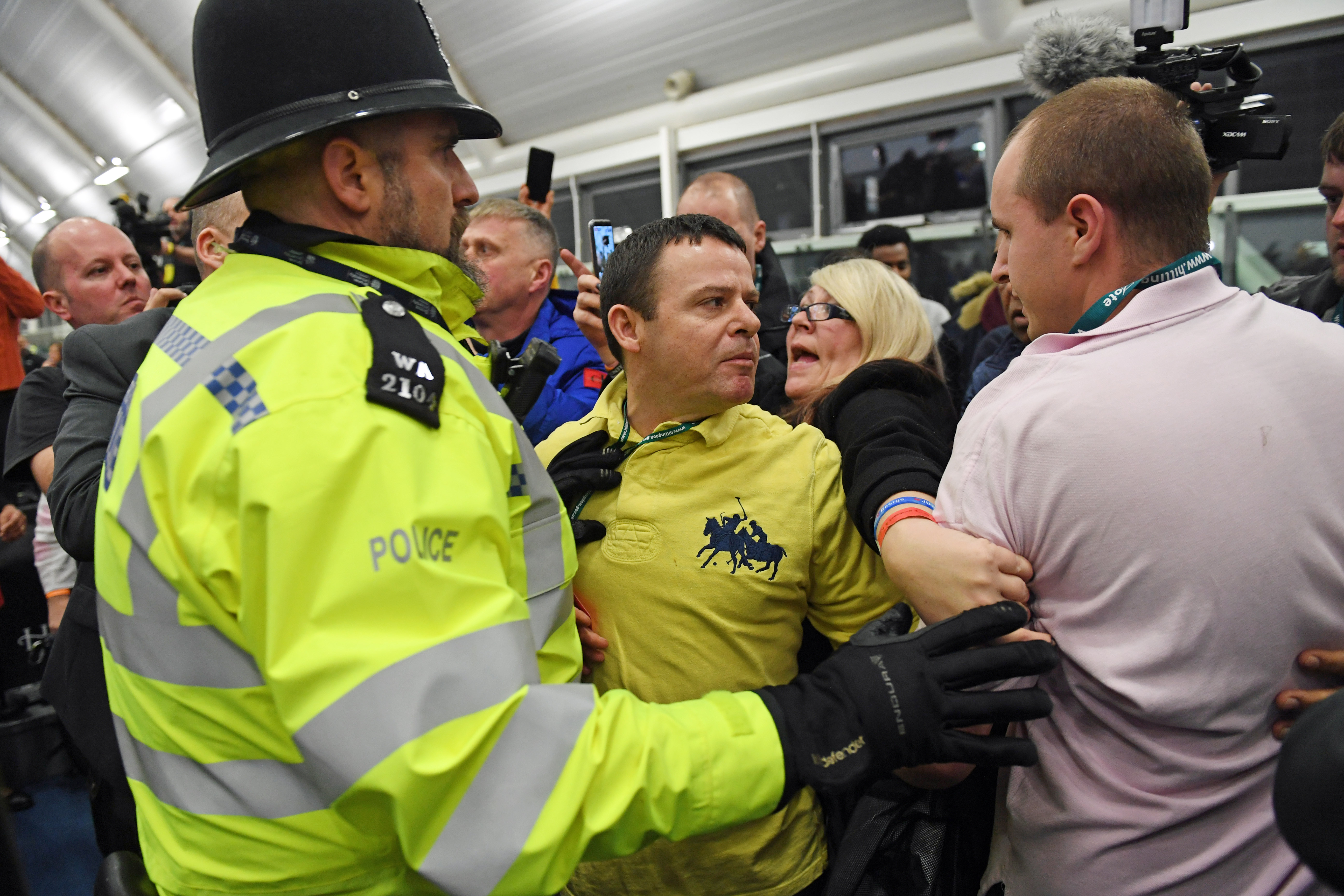 Police with party supporters at the Uxbridge count where Hayes and Harlington MP John McDonnell retained his parliamentary seat after the 2019 General Election, and the result for the Prime Minister's constituency is expected shortly. (Photo by Stefan Rousseau/PA Images via Getty Images)