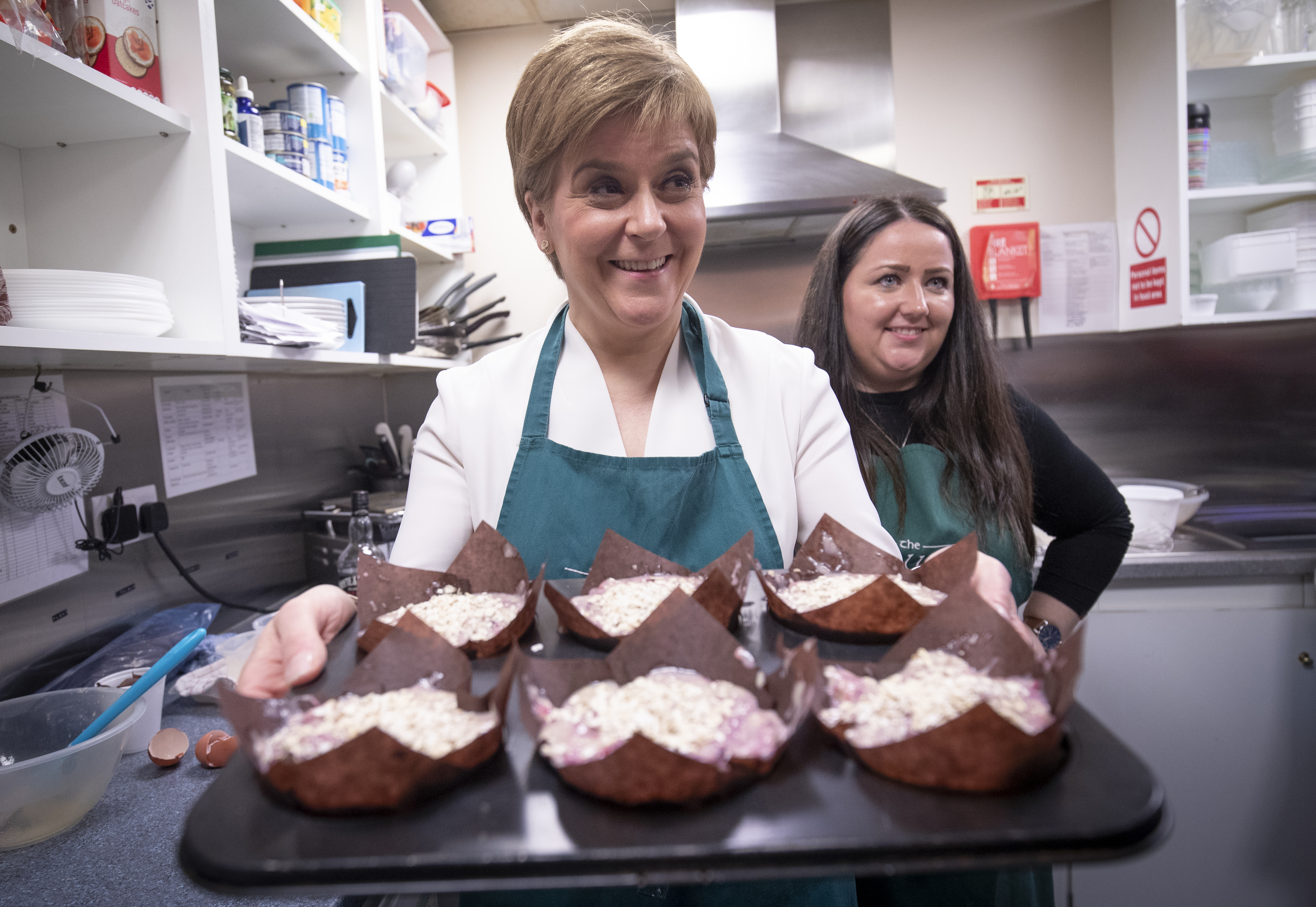 SNP leader Nicola Sturgeon with Angela Crawley (right), SNP Candidate for Lanark and Hamilton East, helps to make muffins during a visit the Wallace tea Rooms in Lanark on the General Election campaign trail.