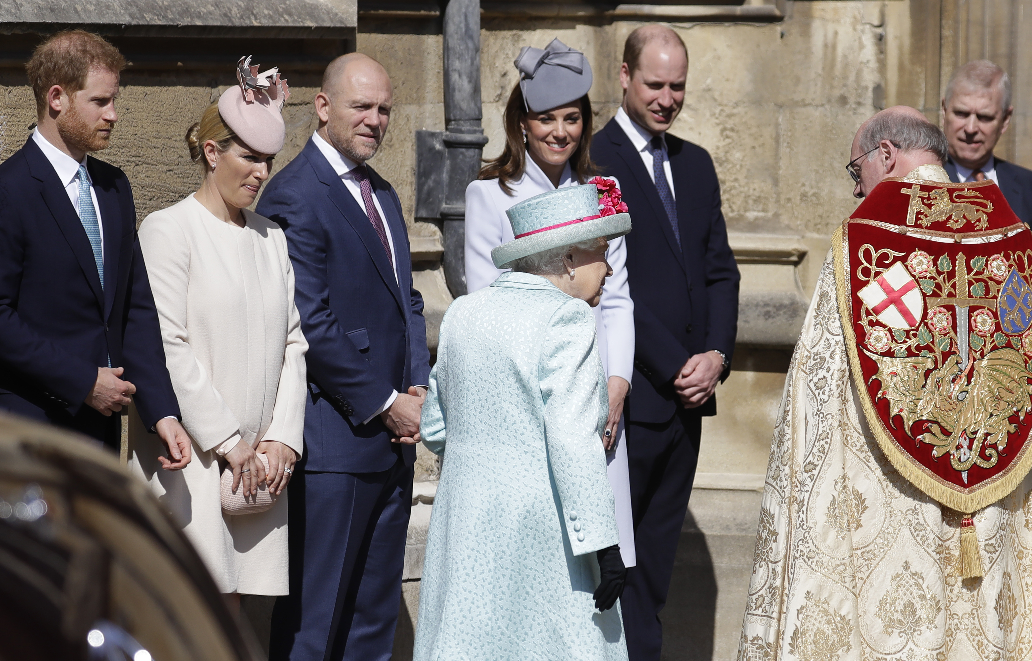 (left to right) The Duke of Sussex, Zara Tindall, Mike Tindall, the Duchess of Cambridge and the Duke of Cambridge greet Queen Elizabeth II as she arrives for the Easter Mattins Service at St George's Chapel, Windsor Castle, Windsor.