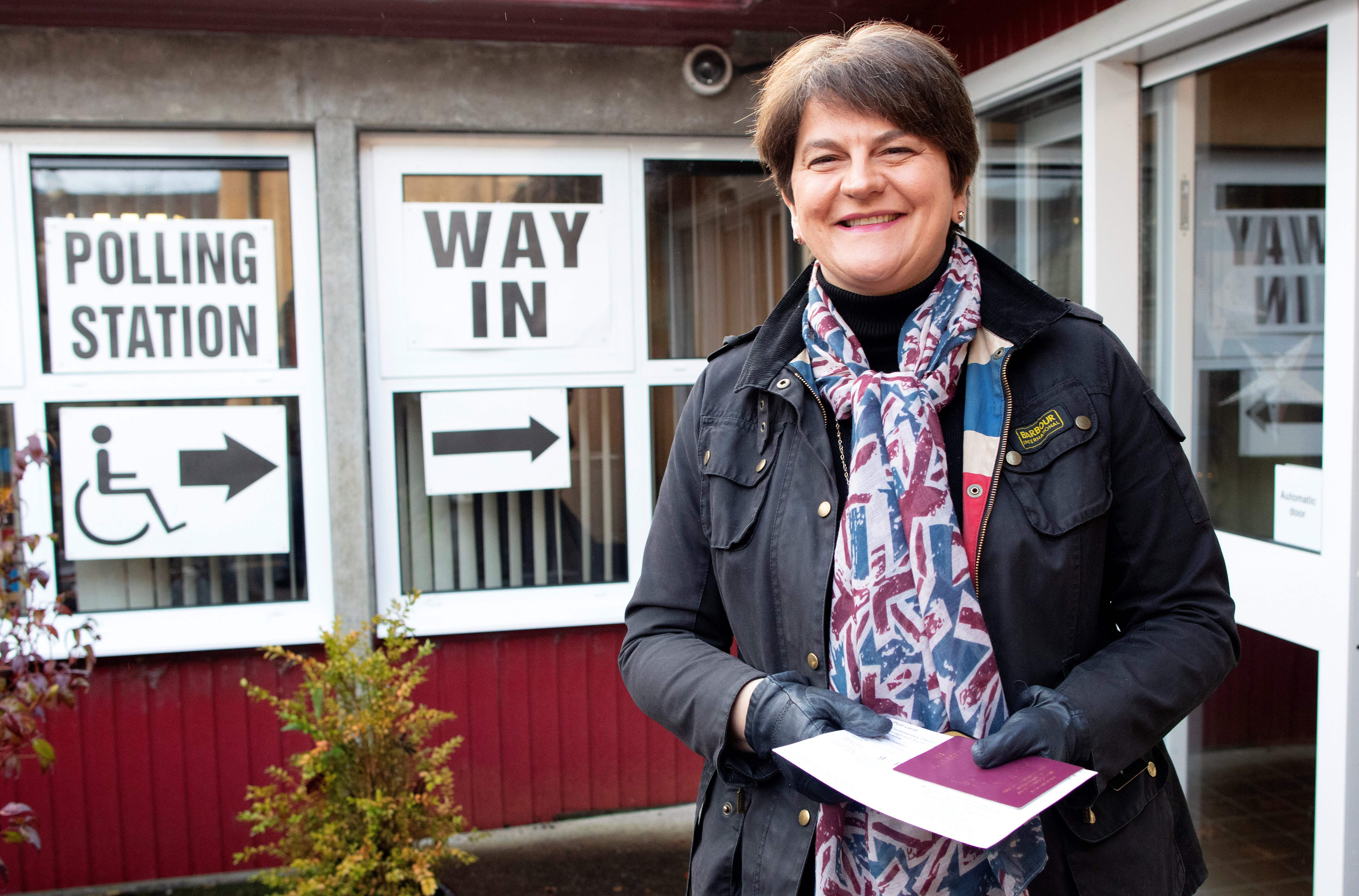 Northern Ireland's Democratic Unionist Party (DUP) leader Arlene Foster wears a Union flag-themed scarff as she arrives at a Polling Station to cast her ballot paper and vote in Brookeborough, Northern Ireland, on December 12, 2019, as Britain holds a general election. (Photo by Paul Faith / AFP) (Photo by PAUL FAITH/AFP via Getty Images)