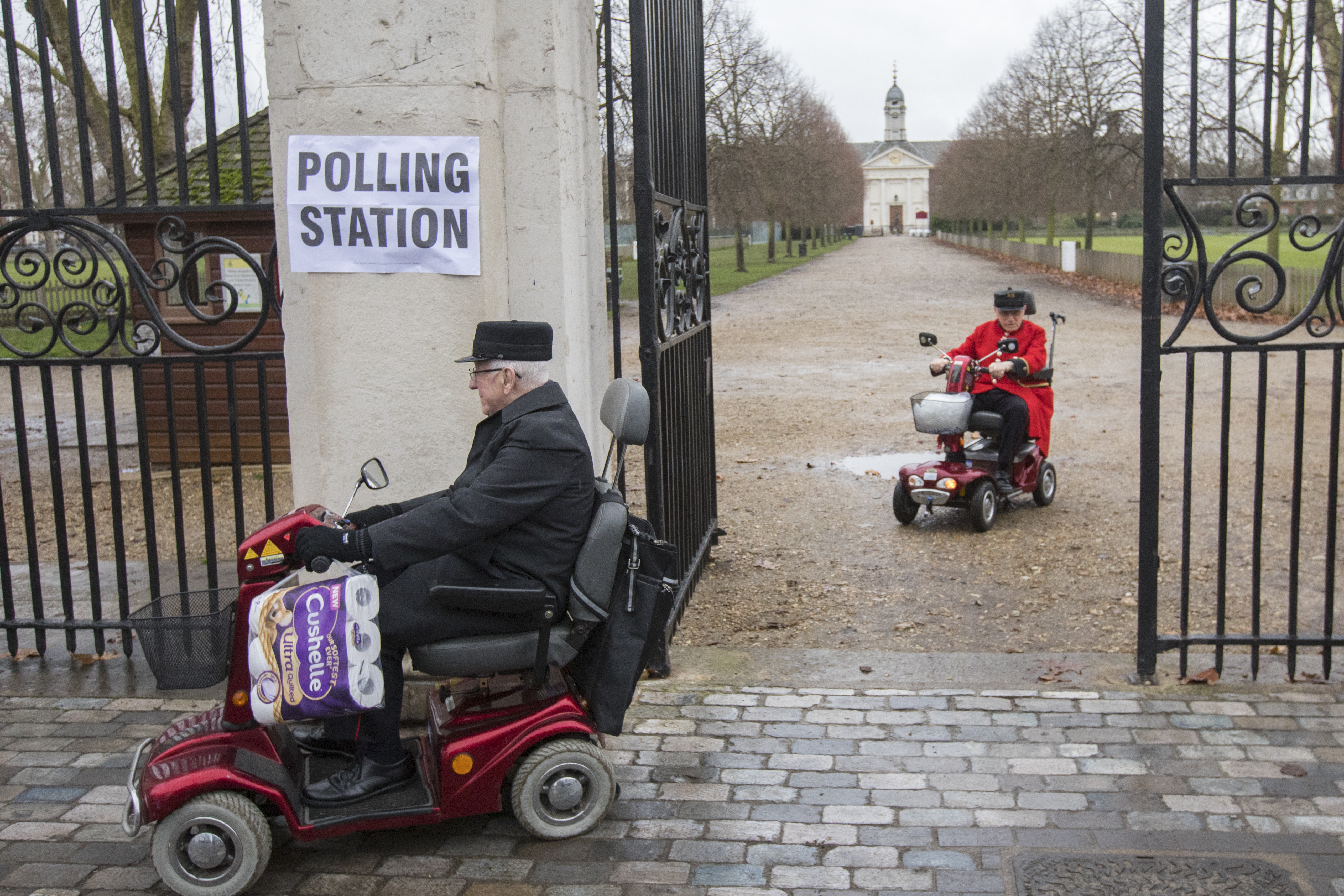 Chelsea Pensioners leave after casting their votes in the 2019 General Election in Chelsea, London. (Photo by Rick Findler/PA Images via Getty Images)