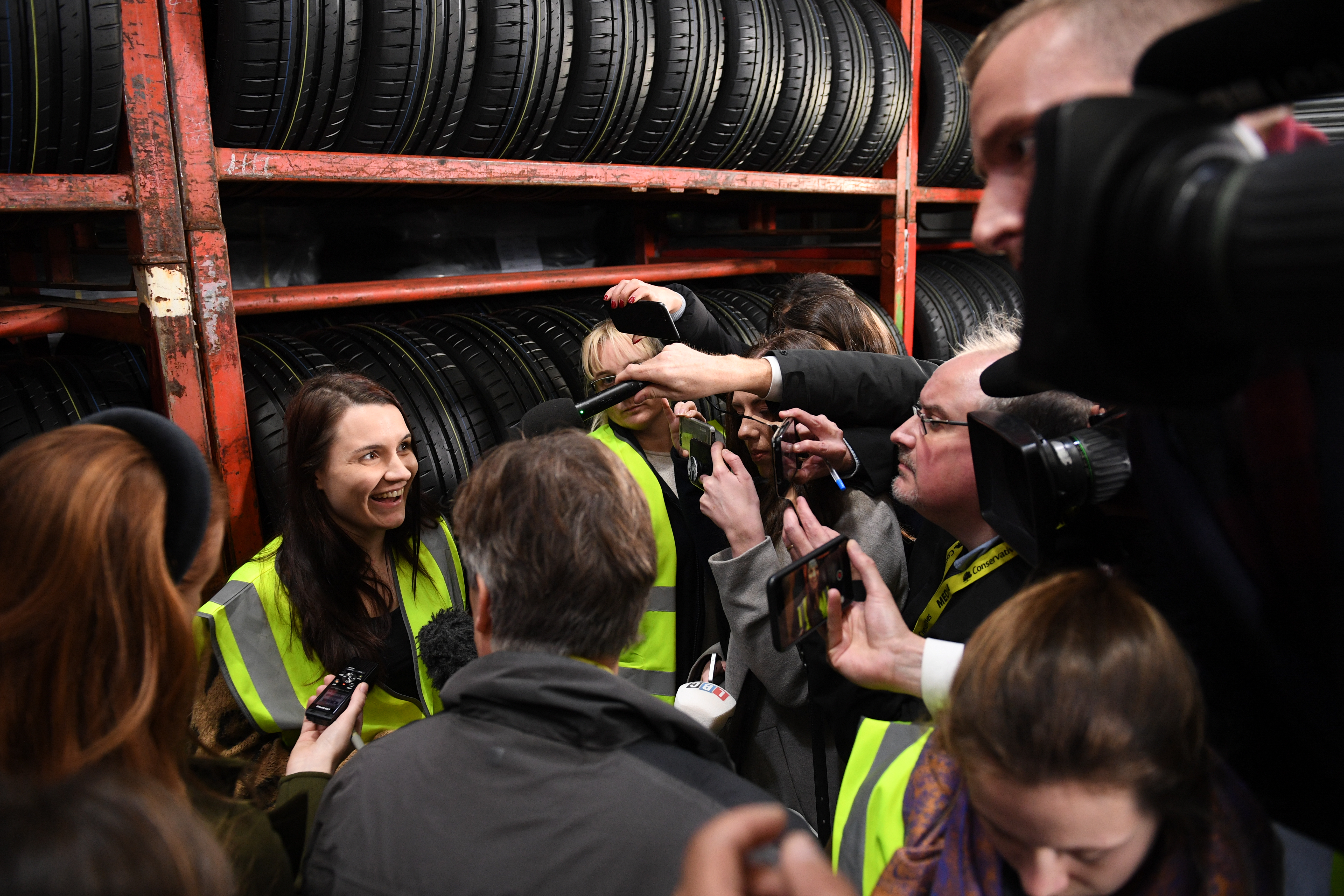 Company administrator Paige Hood, 25, is surrounded by media after she challenged Prime Minister Boris Johnson over the Tories� use of an attack website to make it harder for people to find the Labour manifesto on Google, during his visit to Fergusons Transport in Washington, Tyne & Wear, while on the General Election campaign trail.