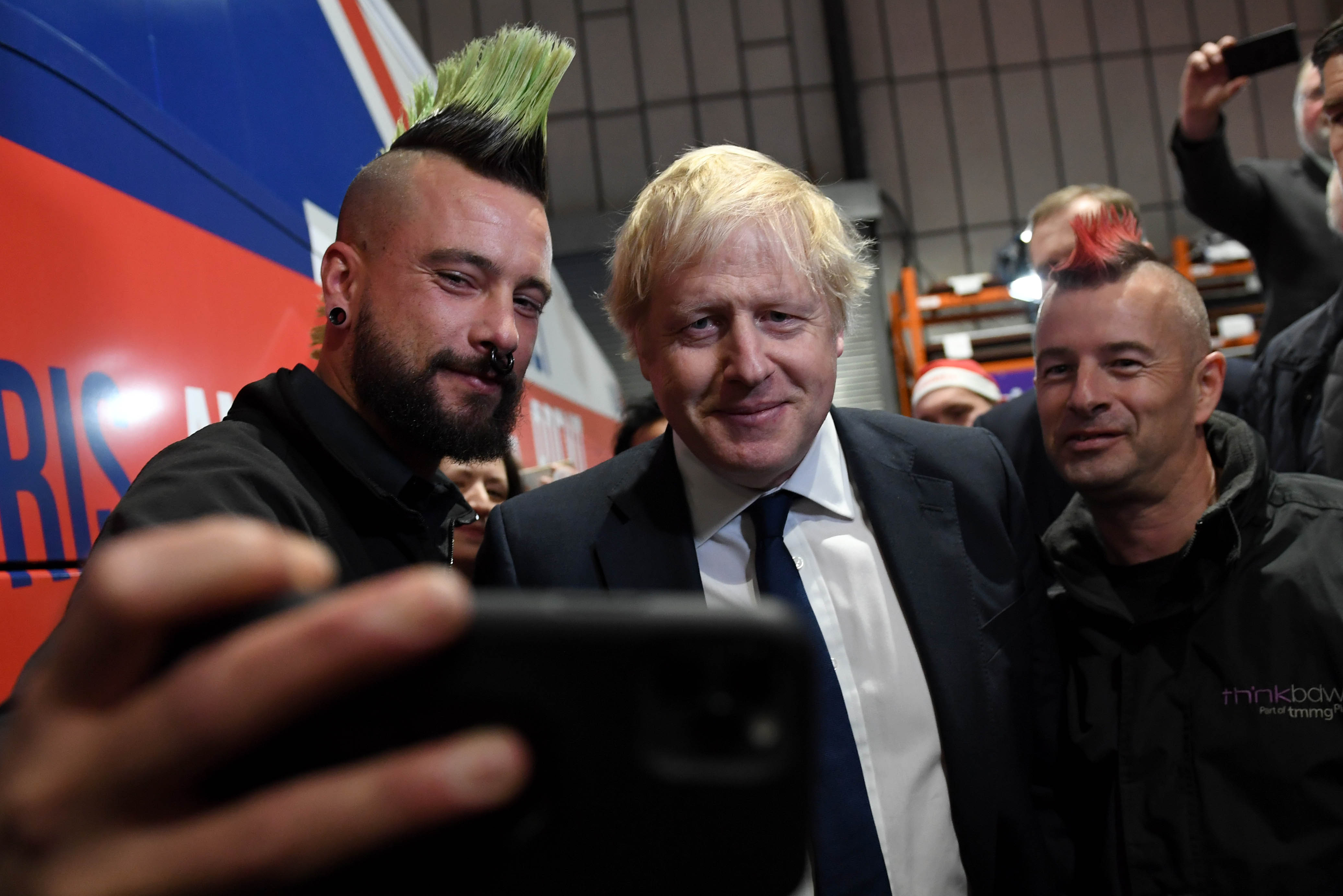 Prime Minister Boris Johnson poses for photos with members during a rally held at property marketing agency, Think BDW, Colchester, while on the General Election campaign trail.