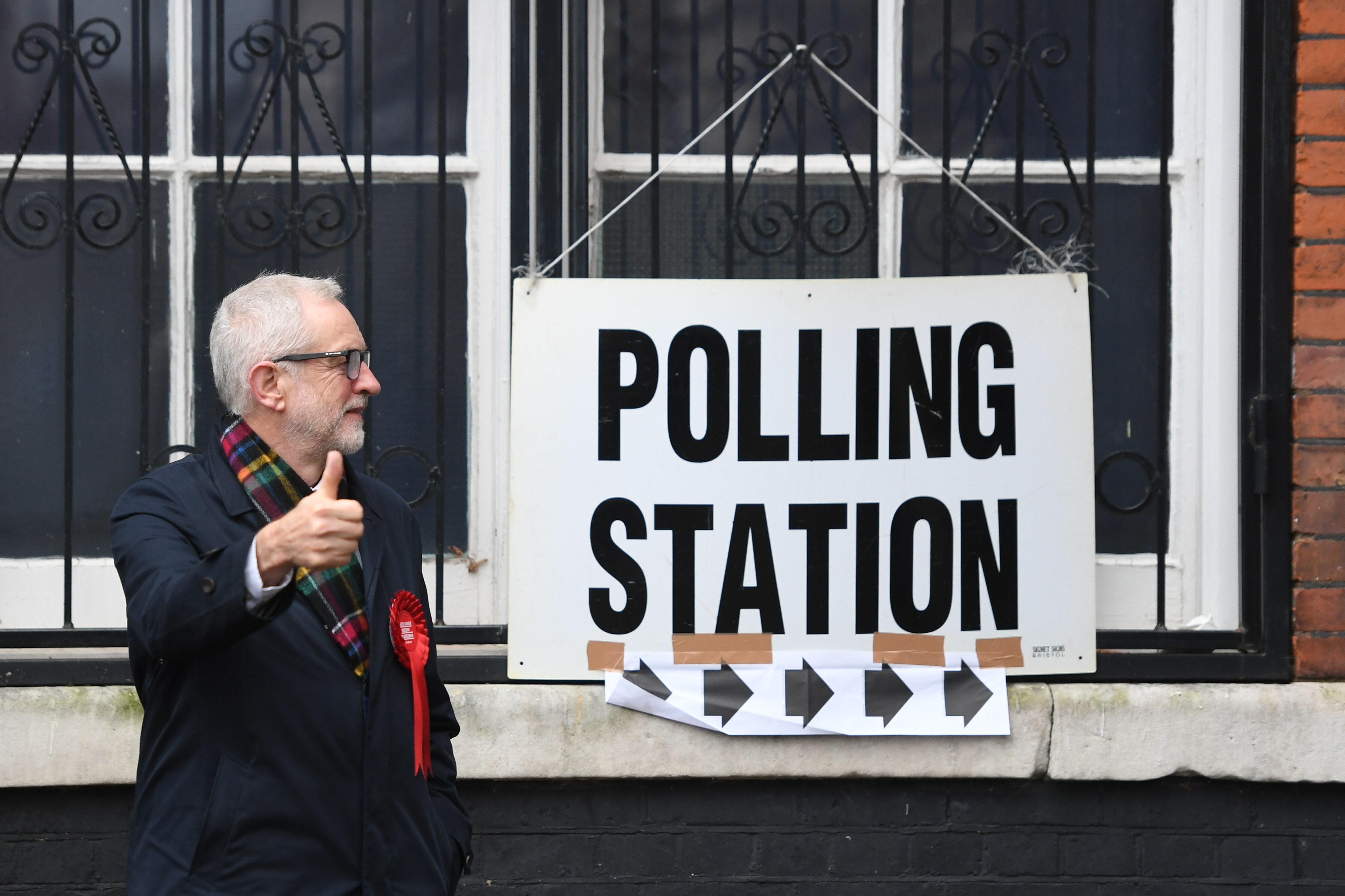 Labour leader Jeremy Corbyn gives a thumbs up as he and his wife Laura Alvarez cast their votes in the 2019 General Election at the polling station at Pakeman Primary School in Islington, north London, (Photo by Joe Giddens/PA Images via Getty Images)