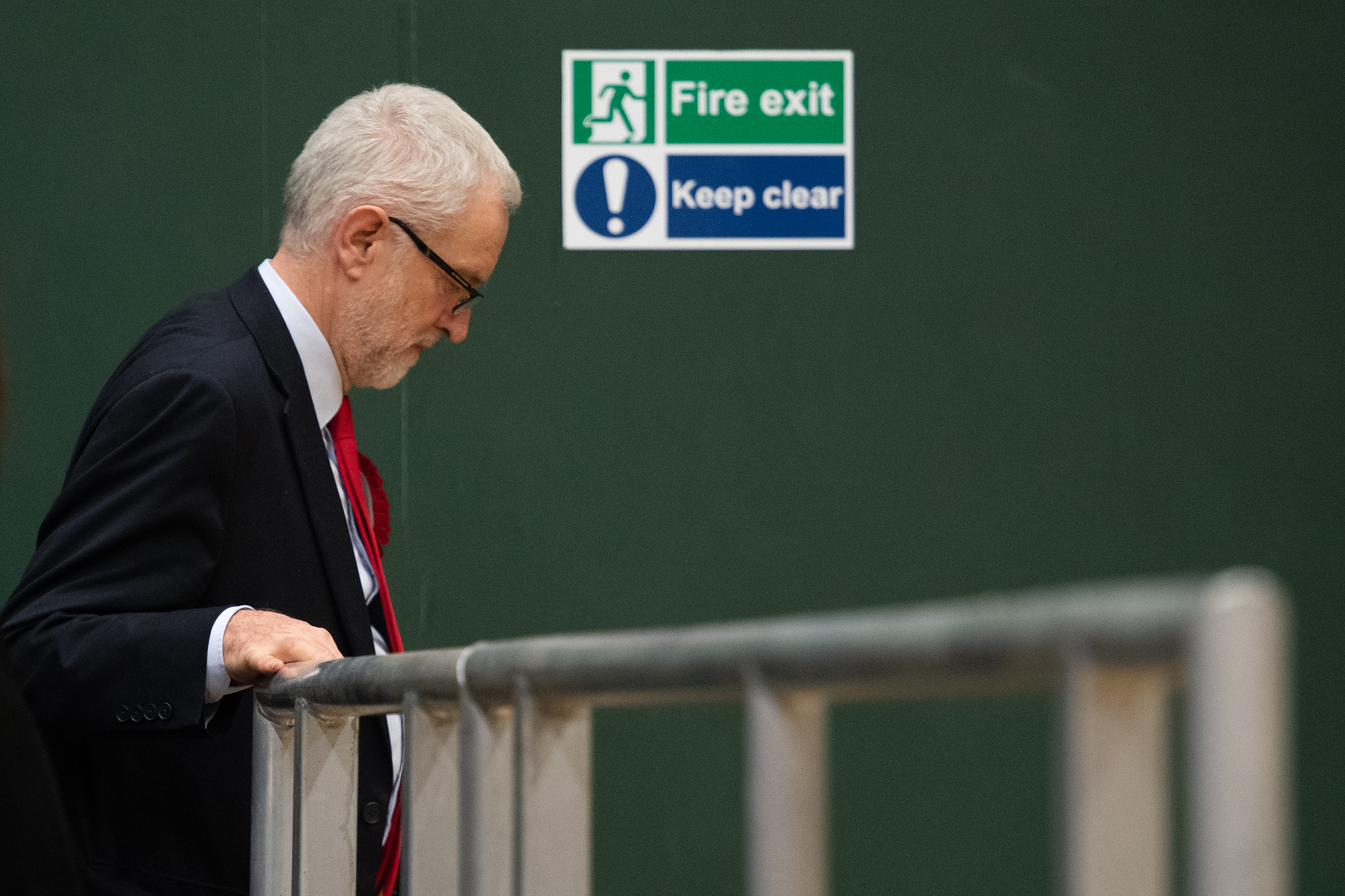 LONDON, ENGLAND - DECEMBER 13: Labour Party leader Jeremy Corbyn leaves the stage at Sobell leisure centre after retaining his parliamentary seat on December 13, 2019 in London, England. Labour leader Jeremy Corbyn has held the Islington North seat since 1983. The current Conservative Prime Minister Boris Johnson called the first UK winter election for nearly a century in an attempt to gain a working majority to break the parliamentary deadlock over Brexit. The election results from across the country are being counted overnight and an overall result is expected in the early hours of Friday morning. (Photo by Leon Neal/Getty Images)