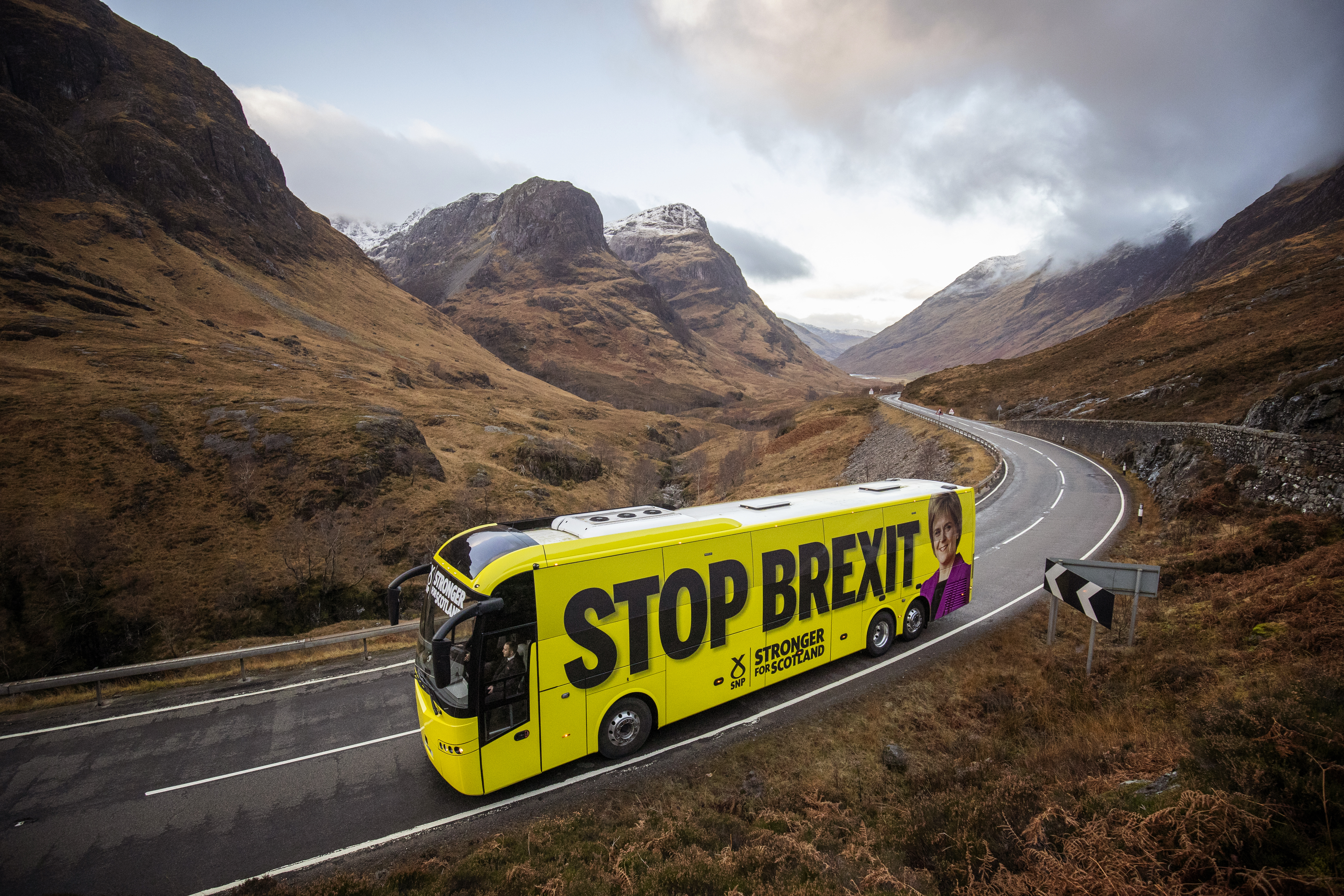 The SNP campaign bus travels up the Pass of Glencoe in the Highlands during its tour of Scotland in the final week of the General Election campaign.