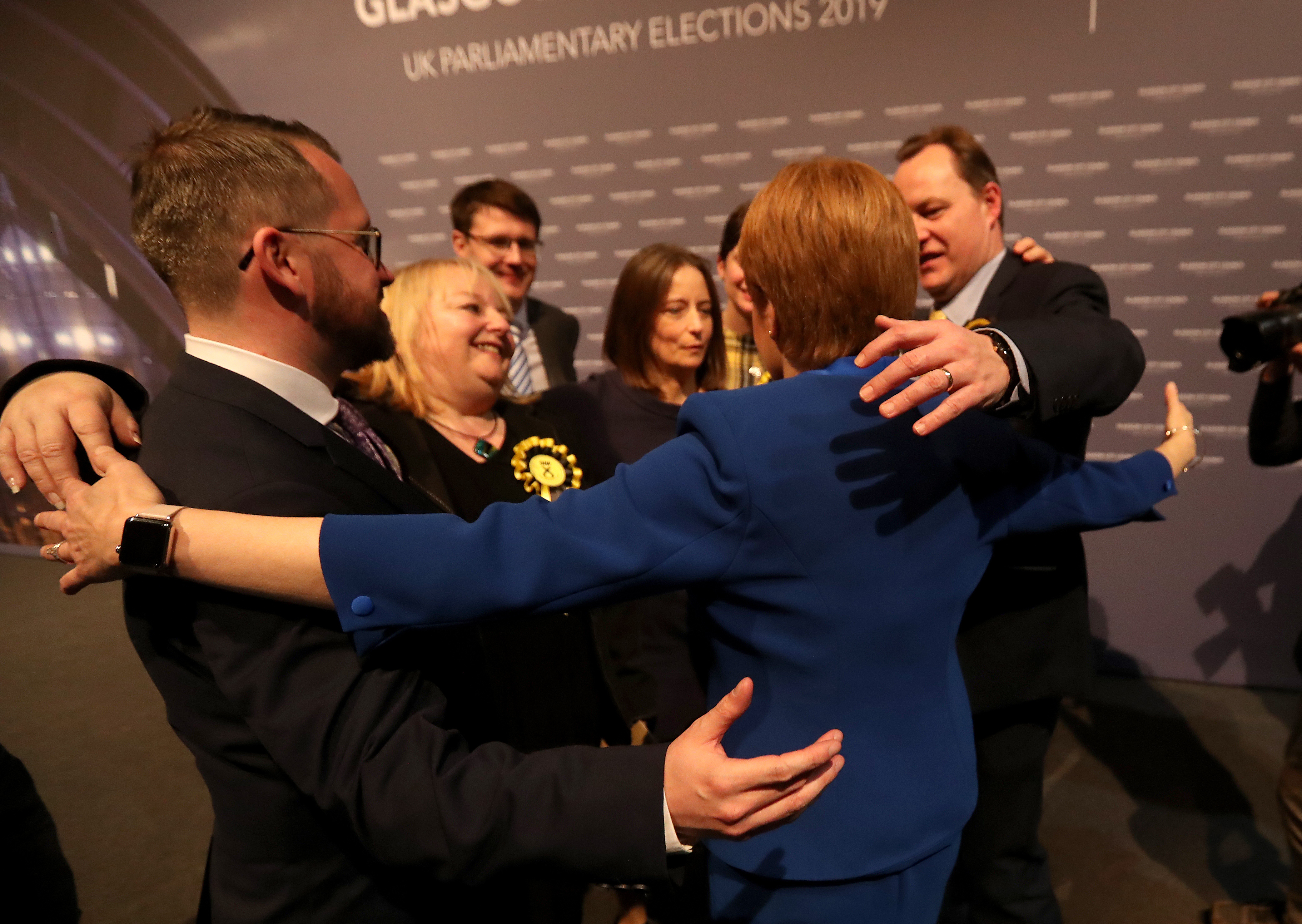 First Minister Nicola Sturgeon hugs her newly elected MPs at the SEC Centre in Glasgow after counting for the 2019 General Election. (Photo by Andrew Milligan/PA Images via Getty Images)