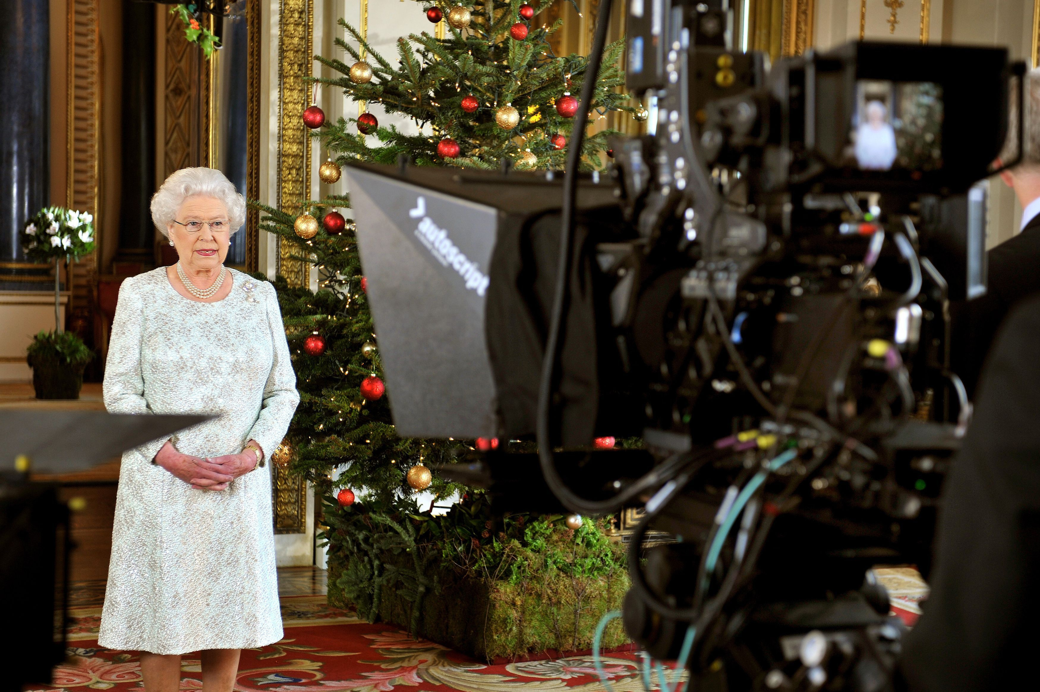 In this picture taken on December 7, 2012 Queen Elizabeth II records her Christmas message to the Commonwealth which is to be broadcast in 3D for the first time, in the White Drawing Room at Buckingham Palace in London .   AFP PHOTO/POOL/ John Stillwell        (Photo credit should read JOHN STILLWELL/AFP via Getty Images)