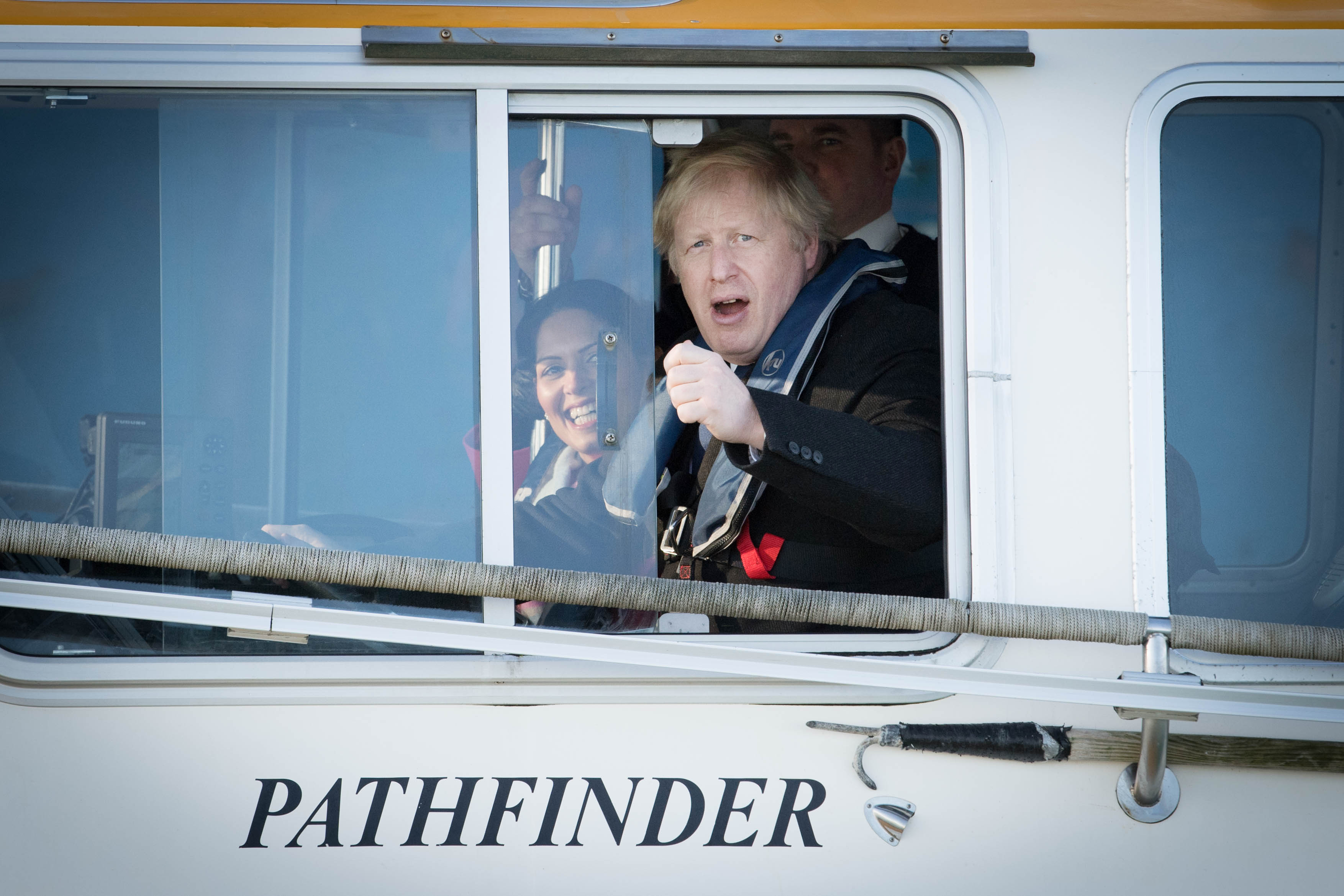 Prime Minister Boris Johnson onboard a boat with Home Secretary Priti Patel during a visit to the Port of Southampton, whilst on the General Election campaign trail.