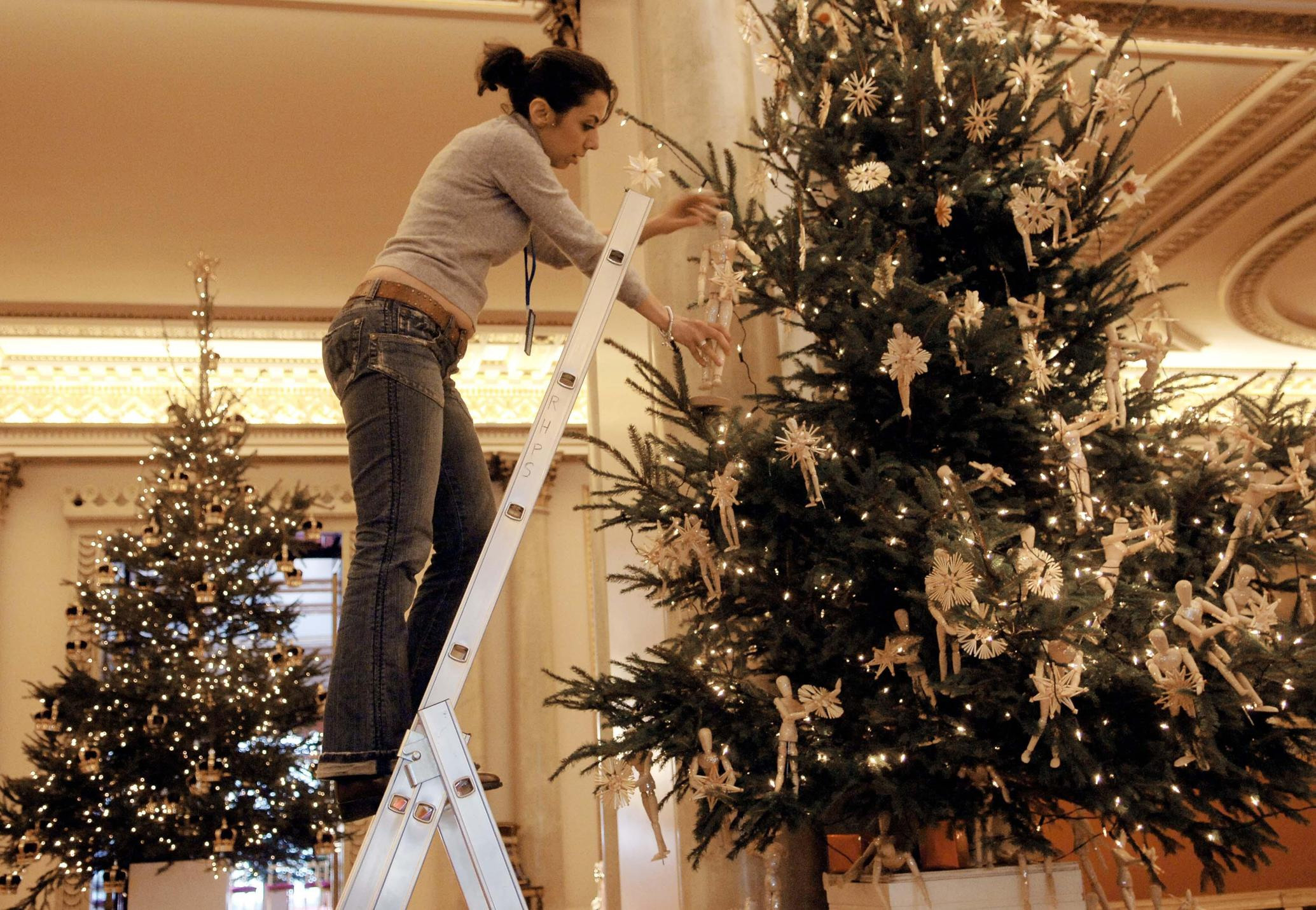 STANDALONE PHOTO  Haleh Niazi of Chelsea College of Art & Design helps decorate a christmas tree in Buckingham Palace today in preparation for tomorrow's young acheivers reception hosted by the Queen and other members of the Royal family.   (Photo by Stefan Rousseau - PA Images/PA Images via Getty Images)