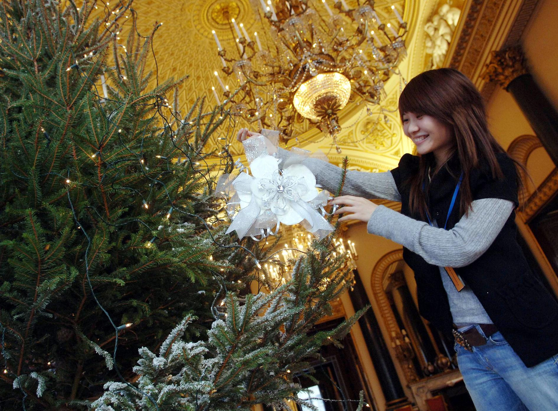STANDALONE PHOTO  Huai-min Hsieh of Chelsea College of Art & Design helps decorate a christmas tree in Buckingham Palace today in preparation for tomorrow's young acheivers reception hosted by the Queen and other members of the Royal family.   (Photo by Stefan Rousseau - PA Images/PA Images via Getty Images)