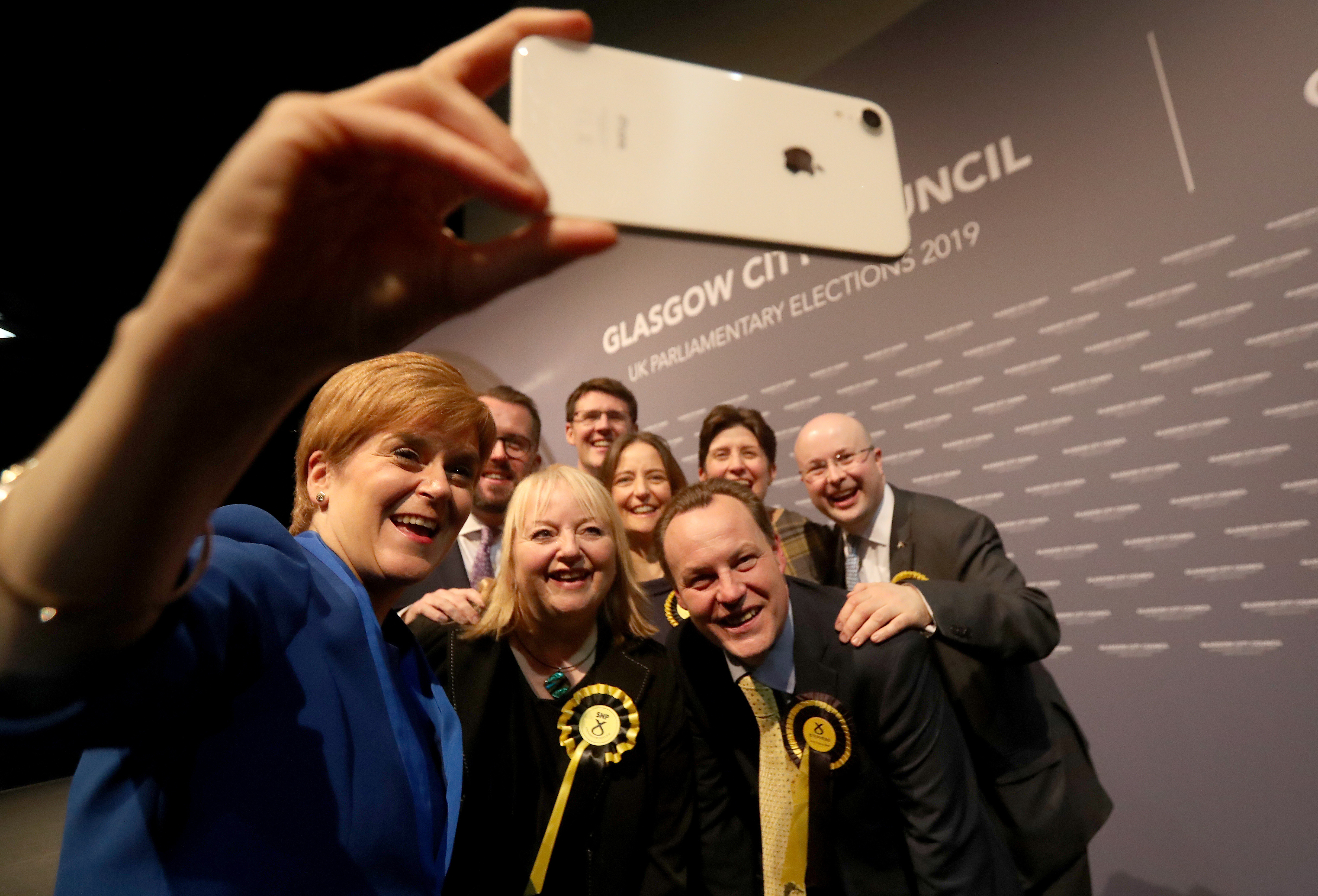 First Minister Nicola Sturgeon takes a selfie with her newly elected MPs at the SEC Centre in Glasgow after counting for the 2019 General Election. (Photo by Andrew Milligan/PA Images via Getty Images)