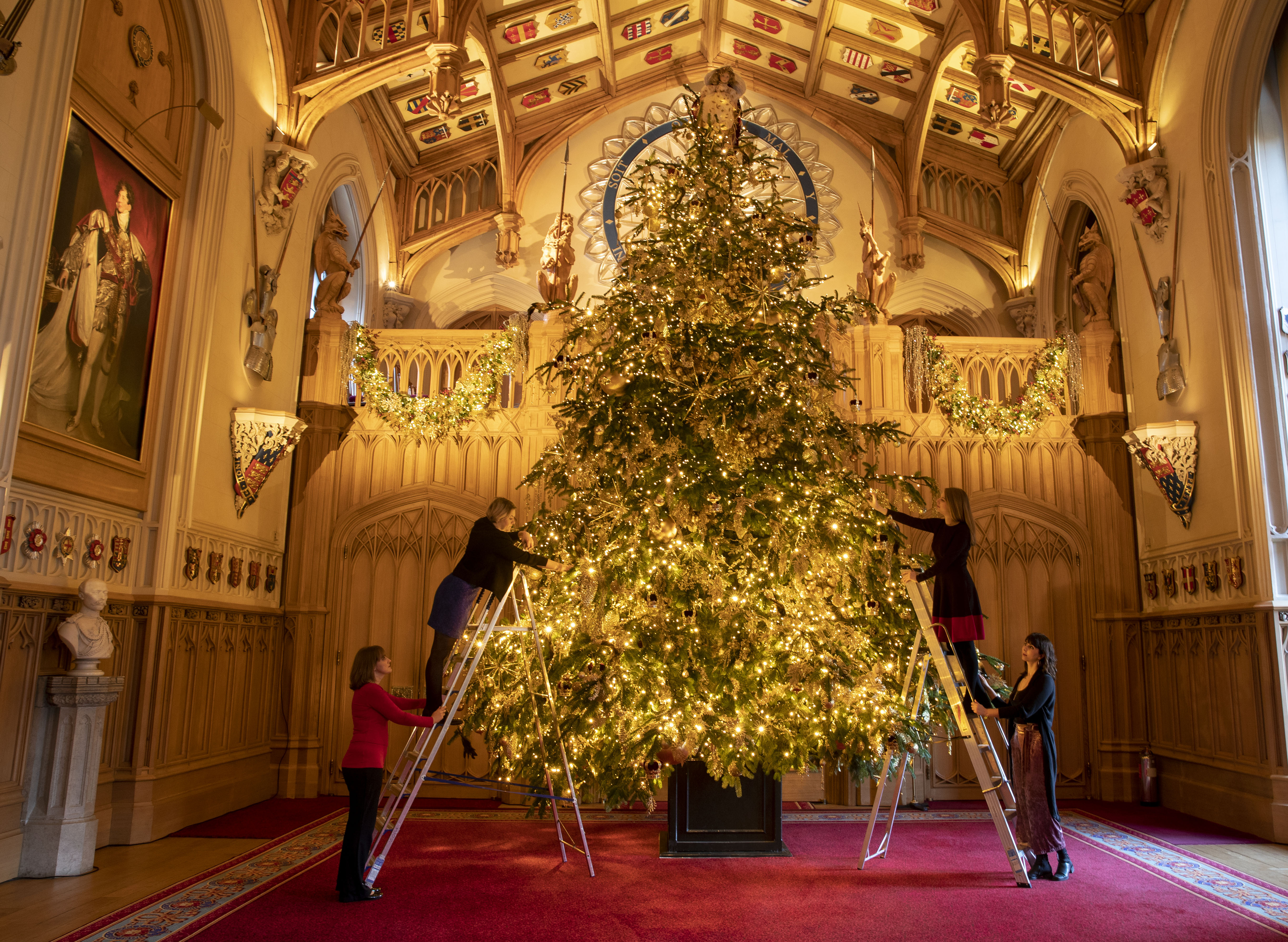 Final preparations are made to a 20ft Norman Fir Christmas tree in St George's Hall at Windsor Castle, Berkshire, which is being decorated for Christmas. (Photo by Steve Parsons/PA Images via Getty Images)