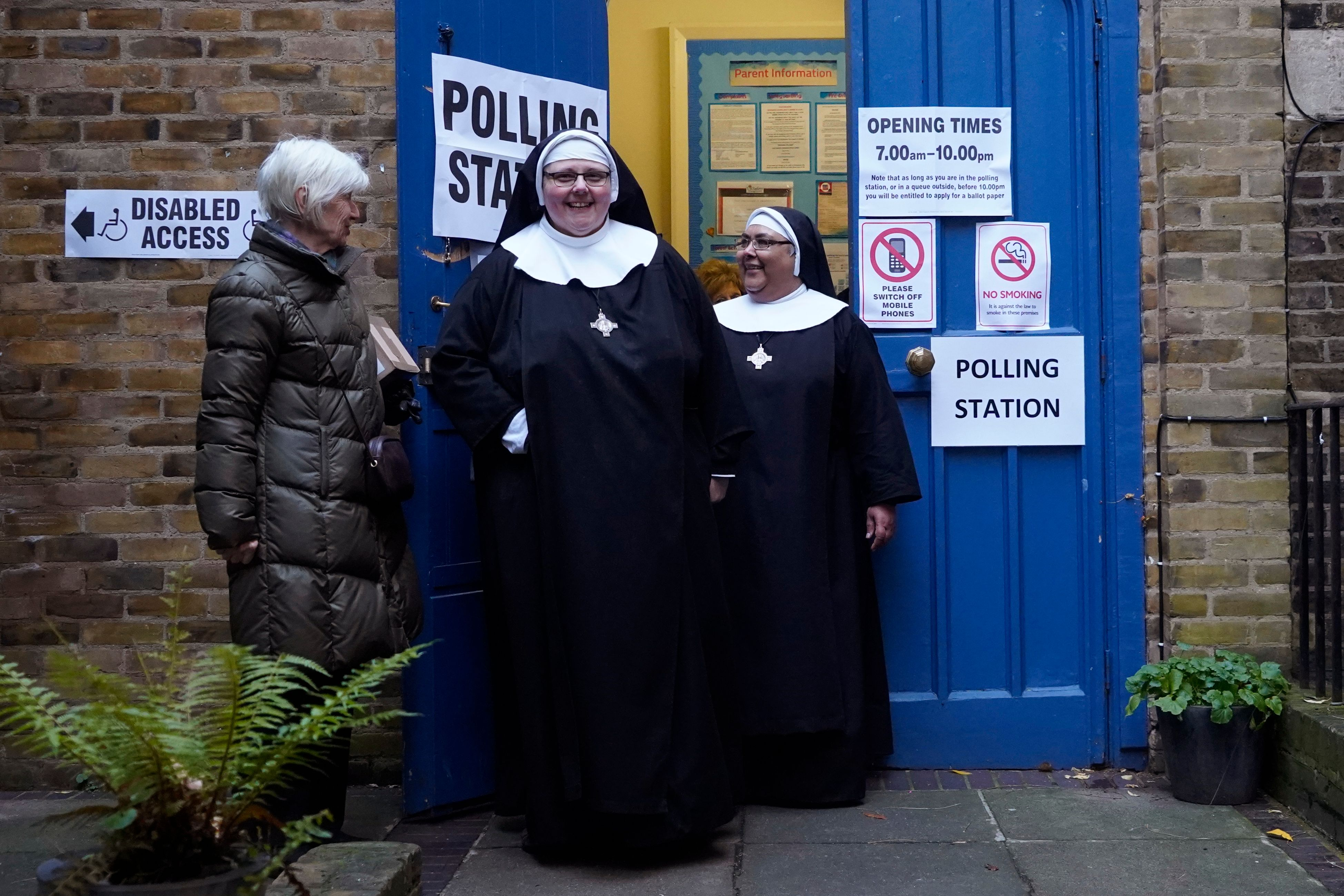 Nuns leave after voting at St John's parish hall polling station in London as Britain holds a general election on December 12, 2019 (Photo by Niklas HALLE'N / AFP) (Photo by NIKLAS HALLE'N/AFP via Getty Images)