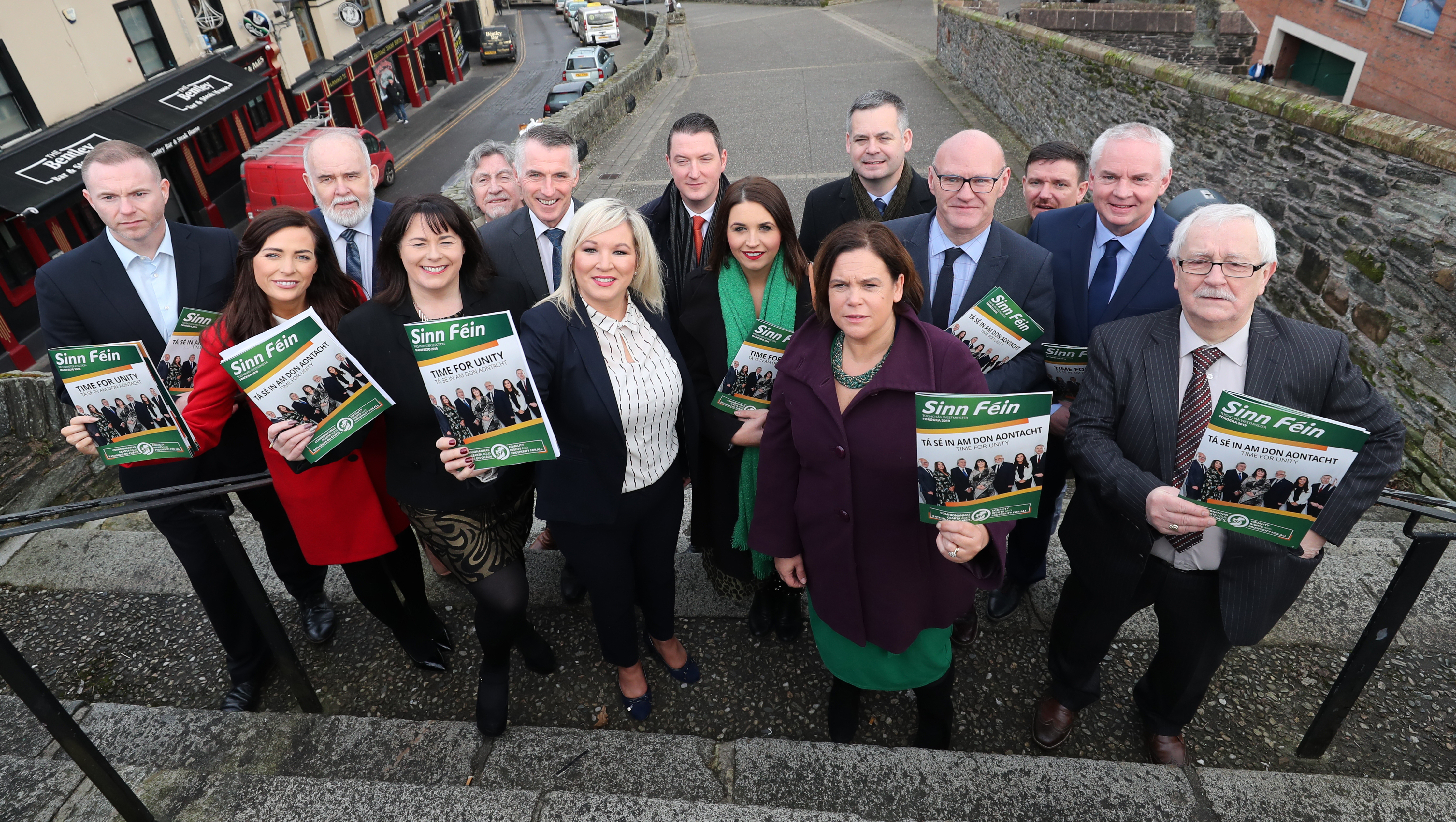 Sinn Fein's Leaders Mary Lou McDonald (centre right) and Michellle O'Neill (centre left) with some of their General Election candidates at the launch of the party's manifesto at the Playhouse Theater in Londonderry.