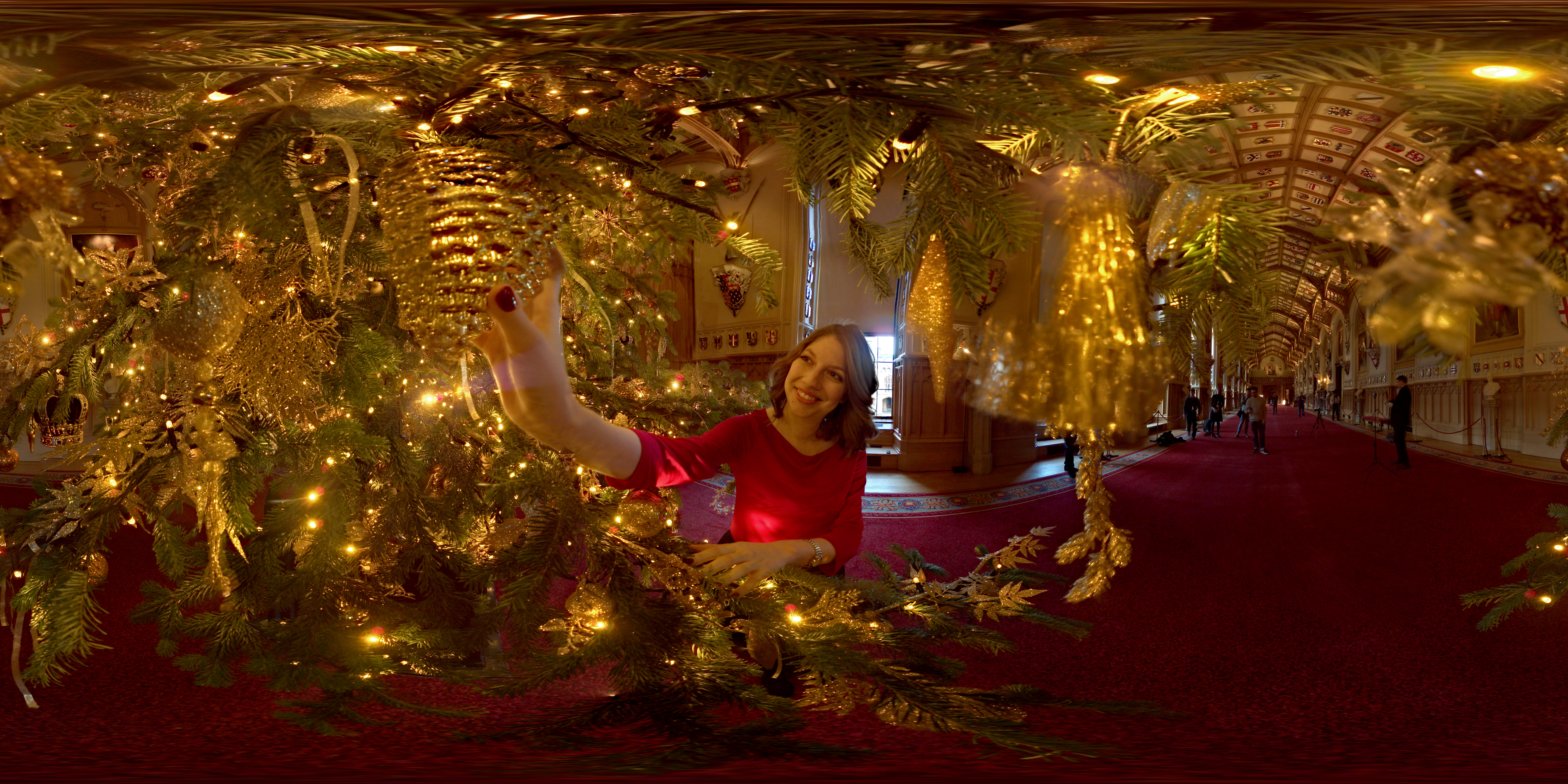 (360 image) A member of the Royal Collection hangs a decoration on a 20ft Nordmann Fir tree from Windsor Great Park in the St George's Hall on November 23, 2017 in Windsor, England.