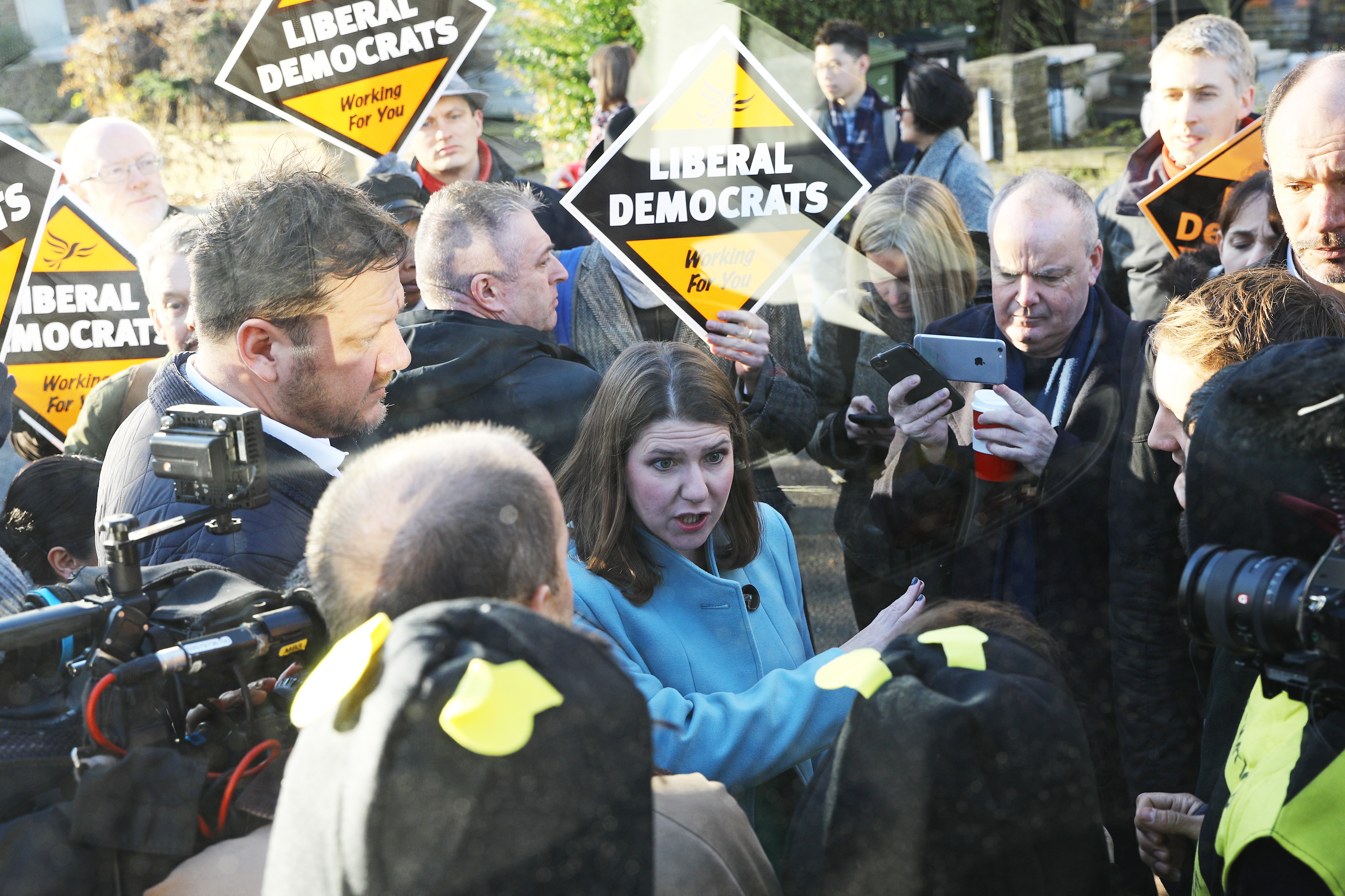 Liberal Democrat Leader Jo Swinson speaks to Extinction Rebellion protesters dressed as bees after they glued themselves to the party's battle bus during a visit to Knights Youth Centre in London, while on the General Election campaign trail.
