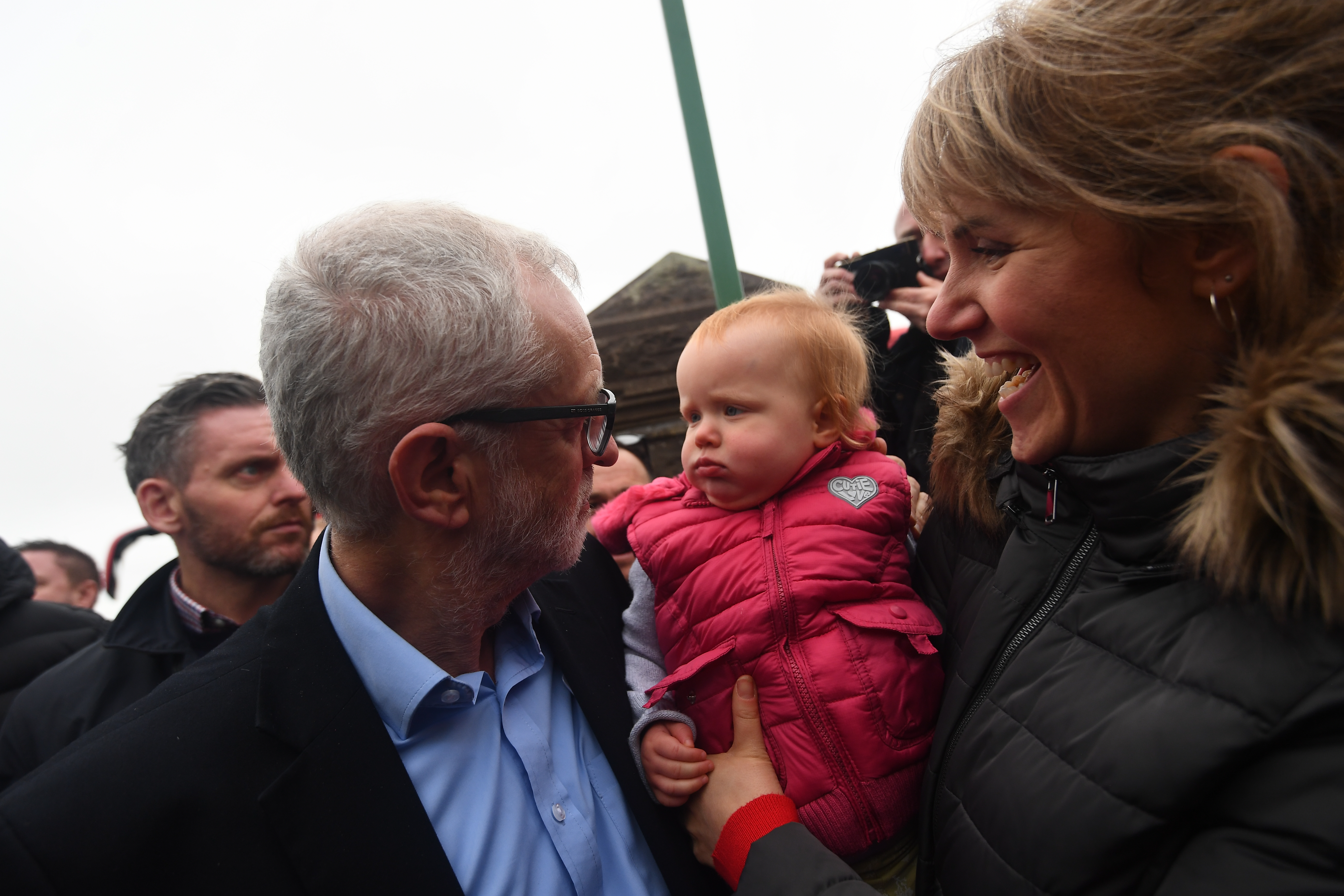 Labour Party leader Jeremy Corbyn looks at a baby during a visit to Swansea, while on the General Election campaign trail in Wales.
