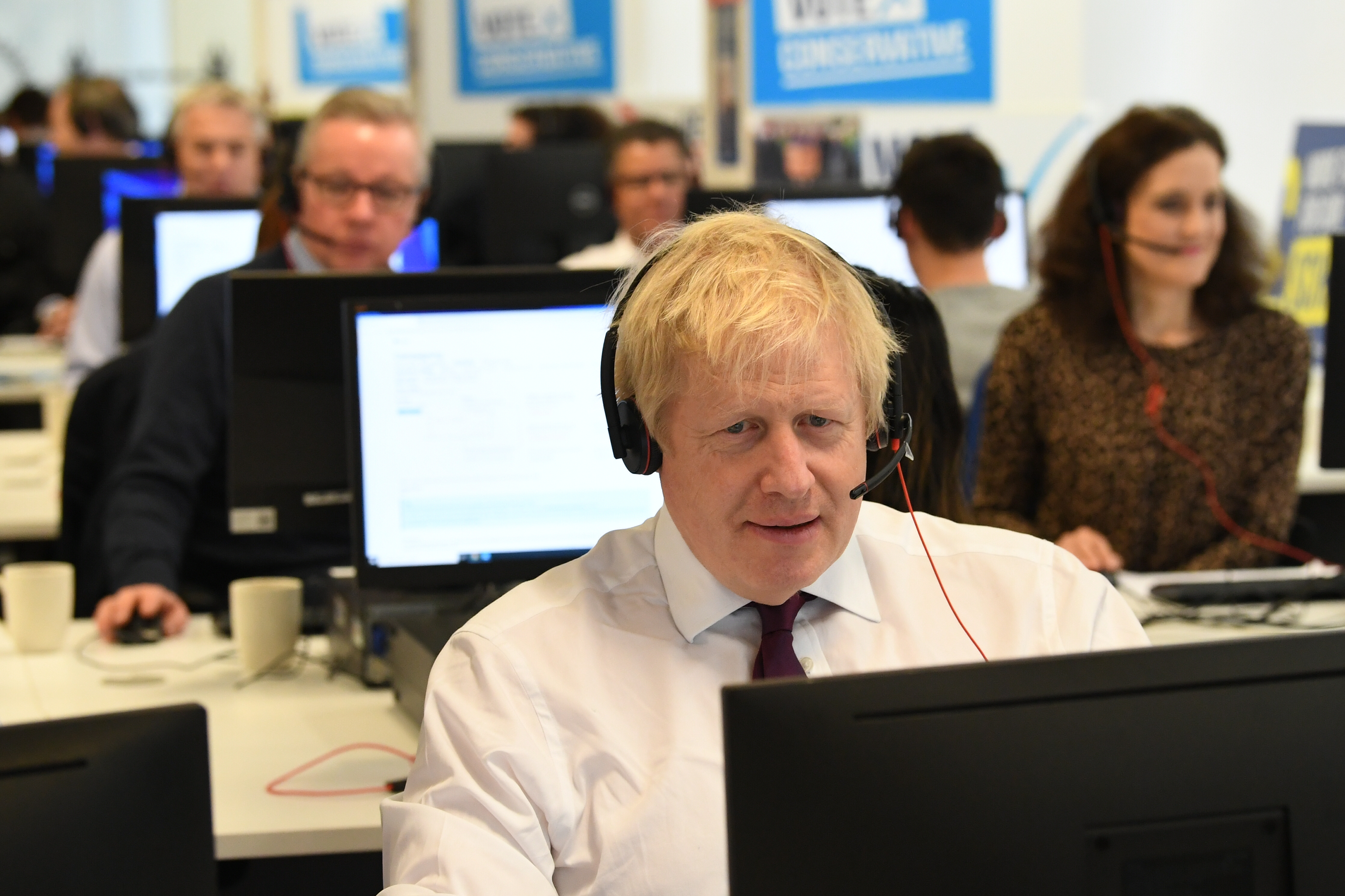 Prime Minister Boris Johnson with other members of his Cabinet at Conservative Campaign Headquarters Call Centre, London, while on the election campaign trail.