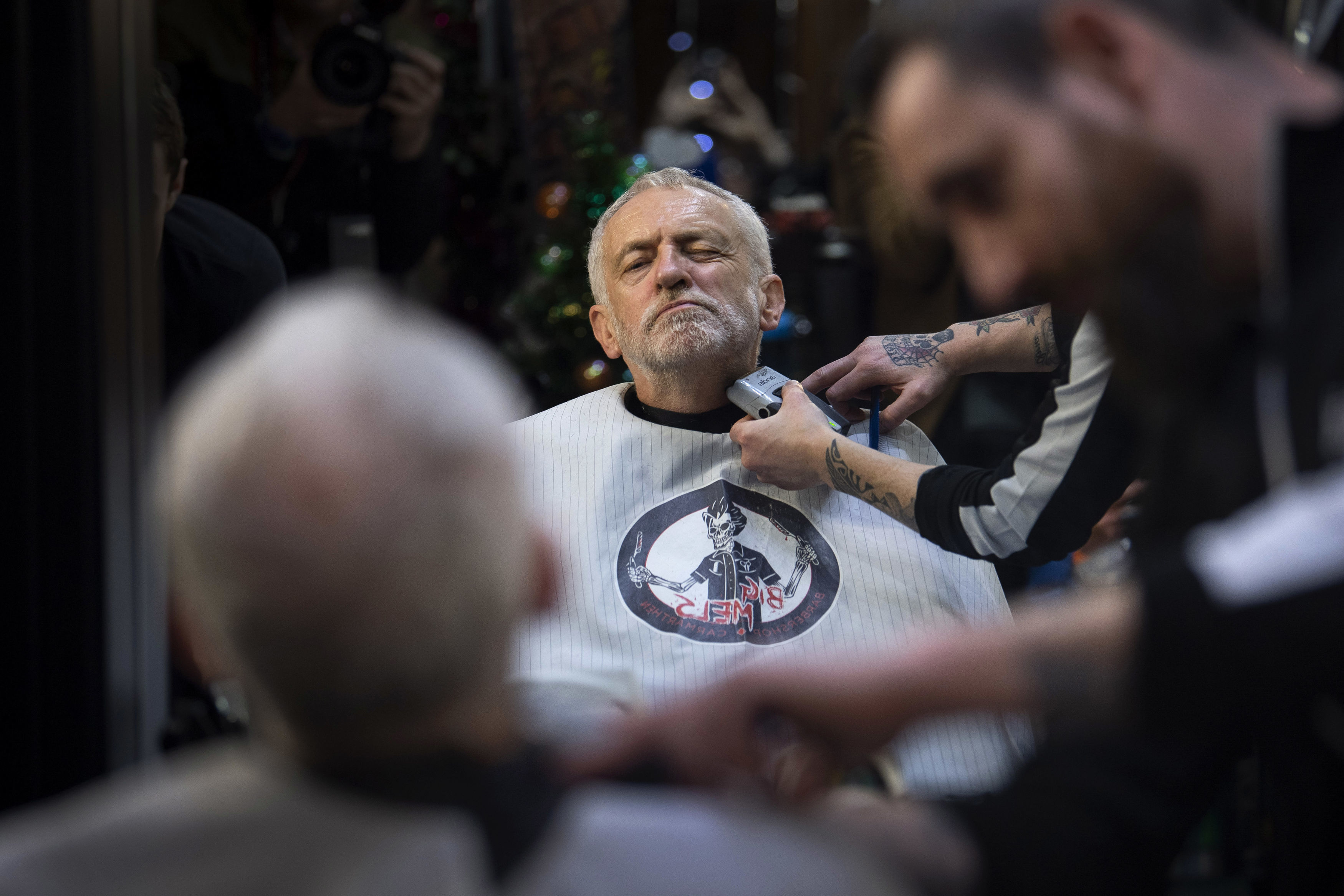 Labour Party leader Jeremy Corbyn in Big Mel's Barbershop, Carmarthen having his beard trimmed, while on the General Election campaign trail in Wales. PA Photo. Picture date: Saturday December 7, 2019. See PA story POLITICS Election. Photo credit should read: Victoria Jones/PA Wire