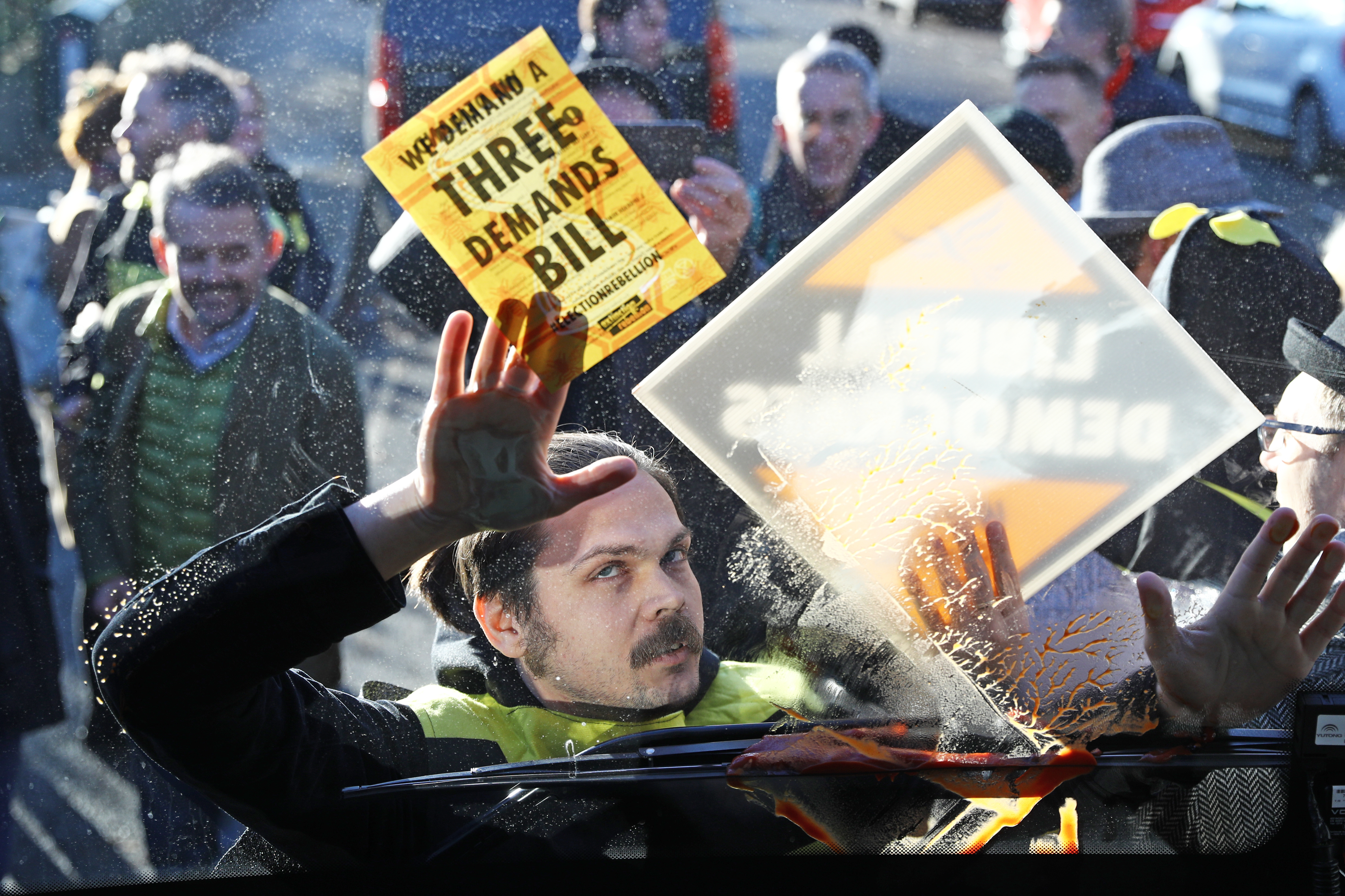 Extinction Rebellion protesters dressed as bees glue themselves to Liberal Democrat Leader Jo Swinson's battle bus during a visit to Knights Youth Centre in London, while on the General Election campaign trail.