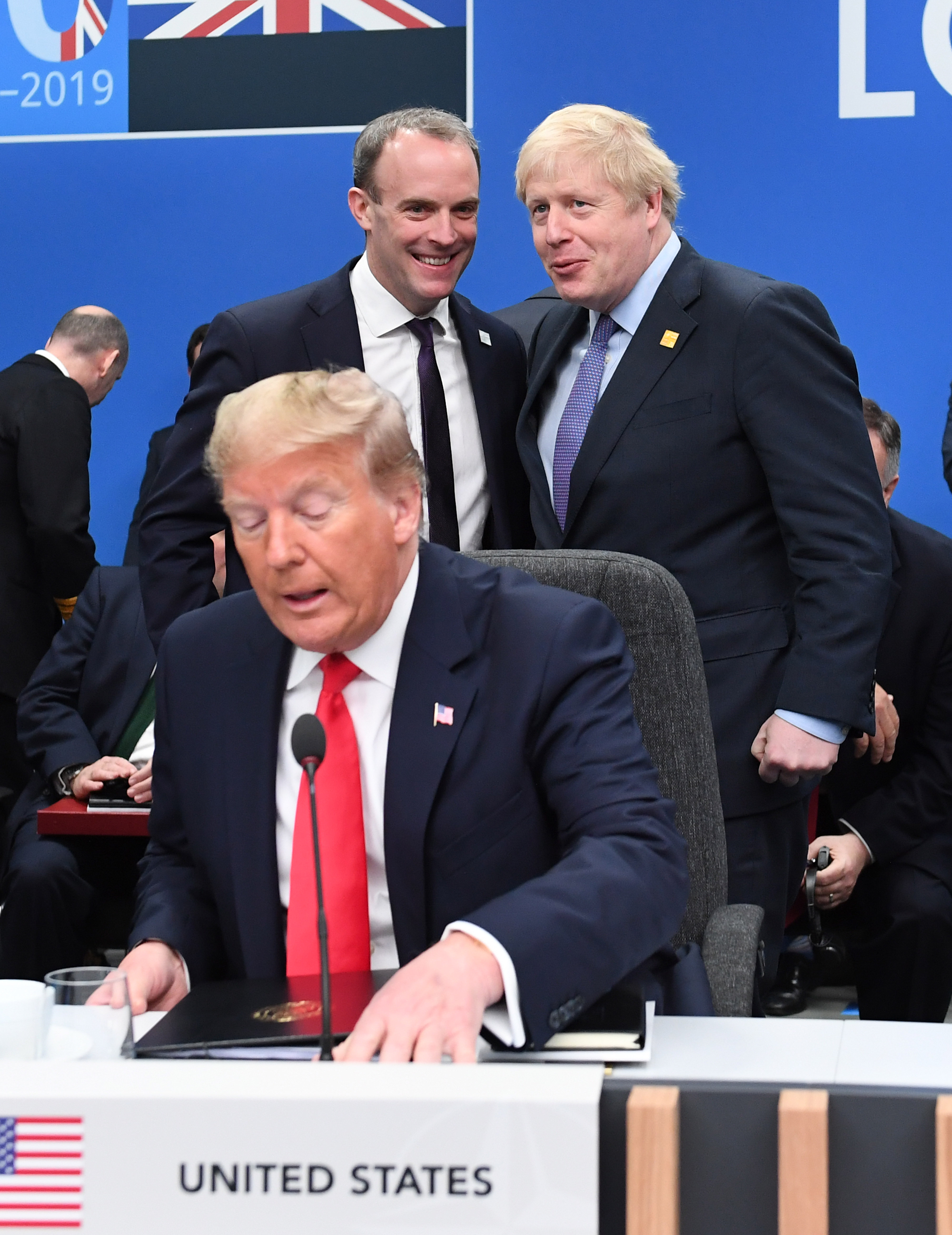 US President Donald Trump (front) with Foreign Secretary Dominic Raab (centre left) snd Prime Minister Boris Johnson(centre right) during the annual Nato heads of government summit at The Grove hotel in Watford, Hertfordshire.