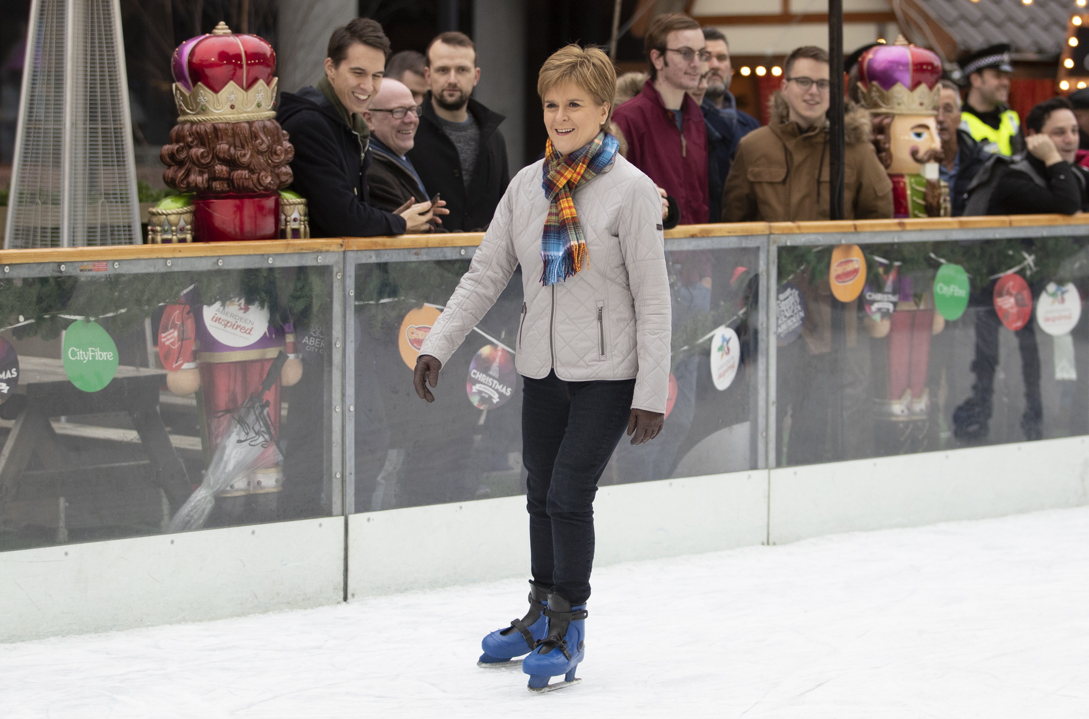 SNP leader Nicola Sturgeon ice skates during a visit to the Aberdeen Christmas Market in The Quad, Marischal College, on the General Election campaign trail. PA Photo. Picture date: Saturday December 7, 2019. See PA story POLITICS Election Sturgeon. Photo credit should read: Jane Barlow/PA Wire