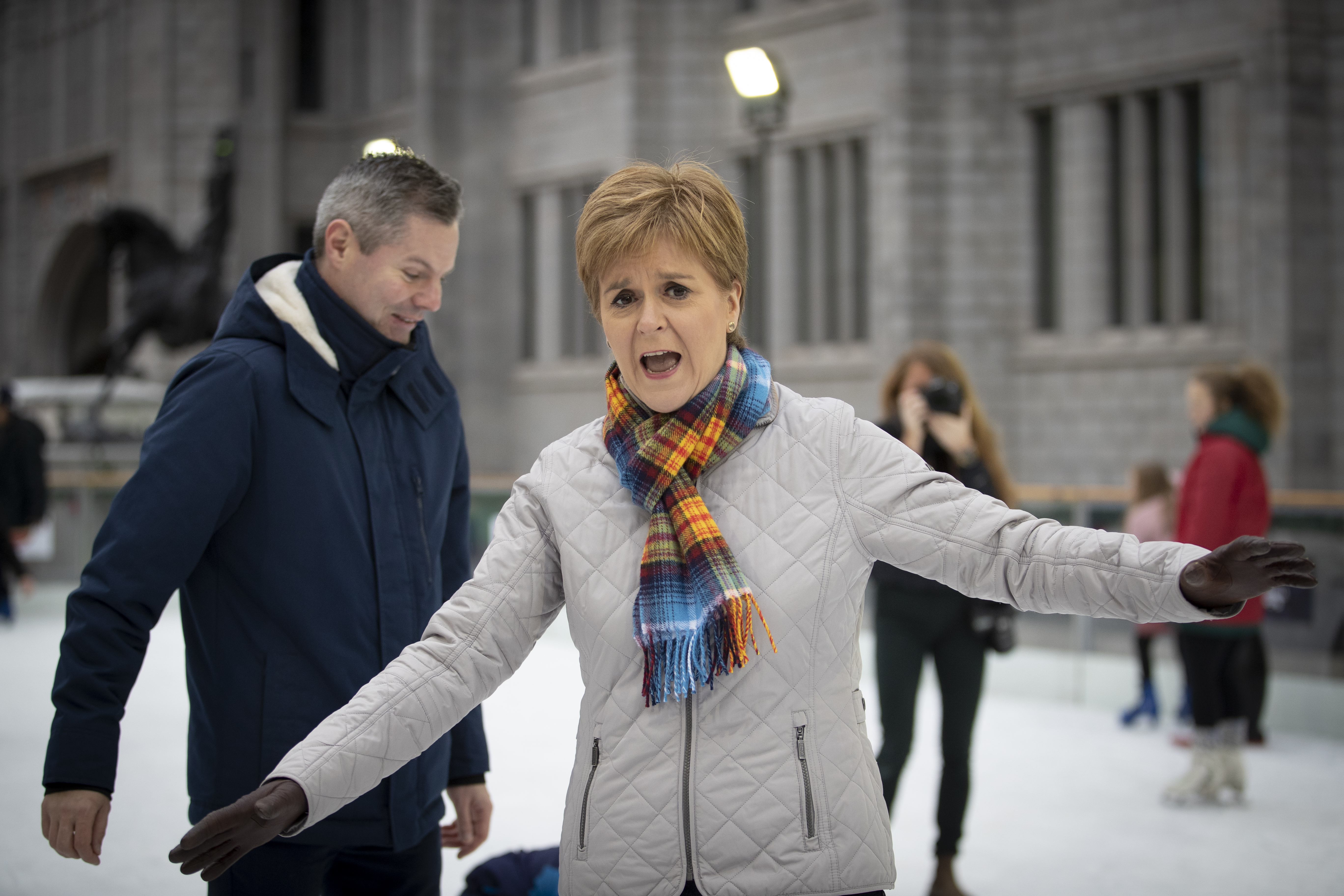 SNP leader Nicola Sturgeon and Finance Secretary Derek Mackay ice skate during a visit to the Aberdeen Christmas Market in The Quad, Marischal College, on the General Election campaign trail.