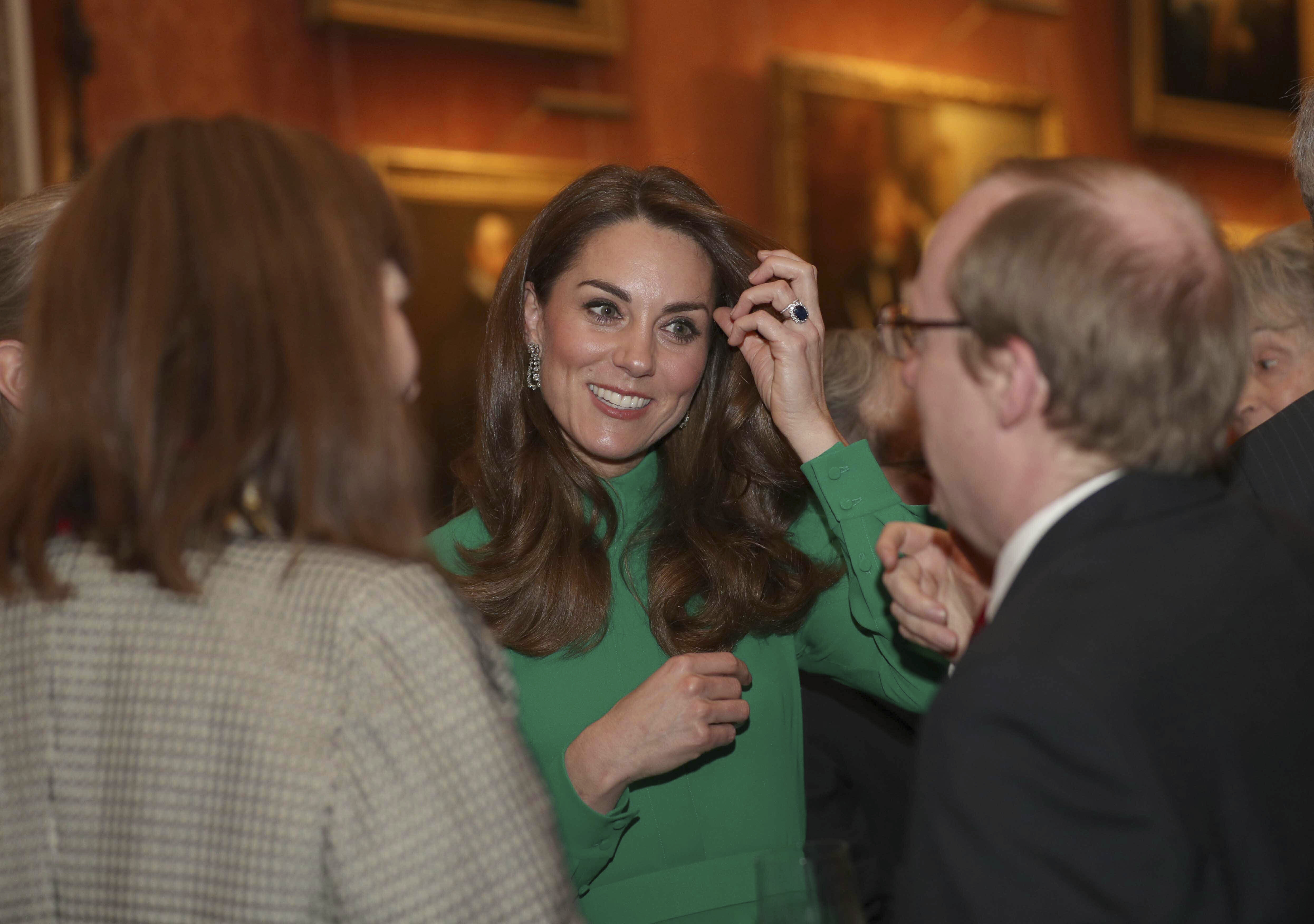 Photo by: KGC-512/STAR MAX/IPx 2019 12/3/19 The Queen, accompanied by other Members of the Royal Family, hosts a reception for NATO leaders, spouses or partners, and delegations, at Buckingham Palace in London, England. Here, Catherine, Duchess of Cambridge