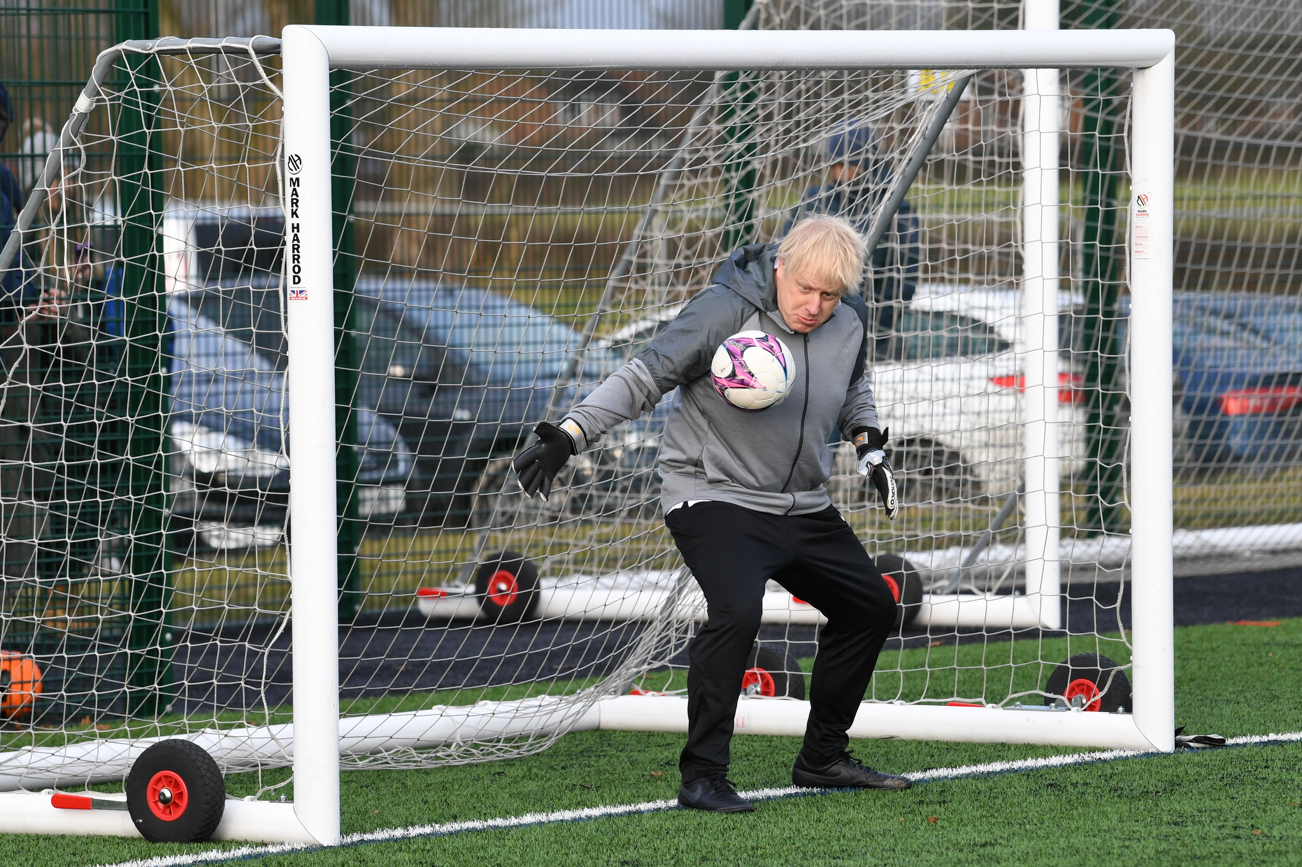 Prime Minister Boris Johnson tries his hand in goal before a football match between Hazel Grove Utd and Poynton Jnr u10s in the Cheshire Girls football league in Cheadle Hume, Cheshire, while on the election campaign trail.
