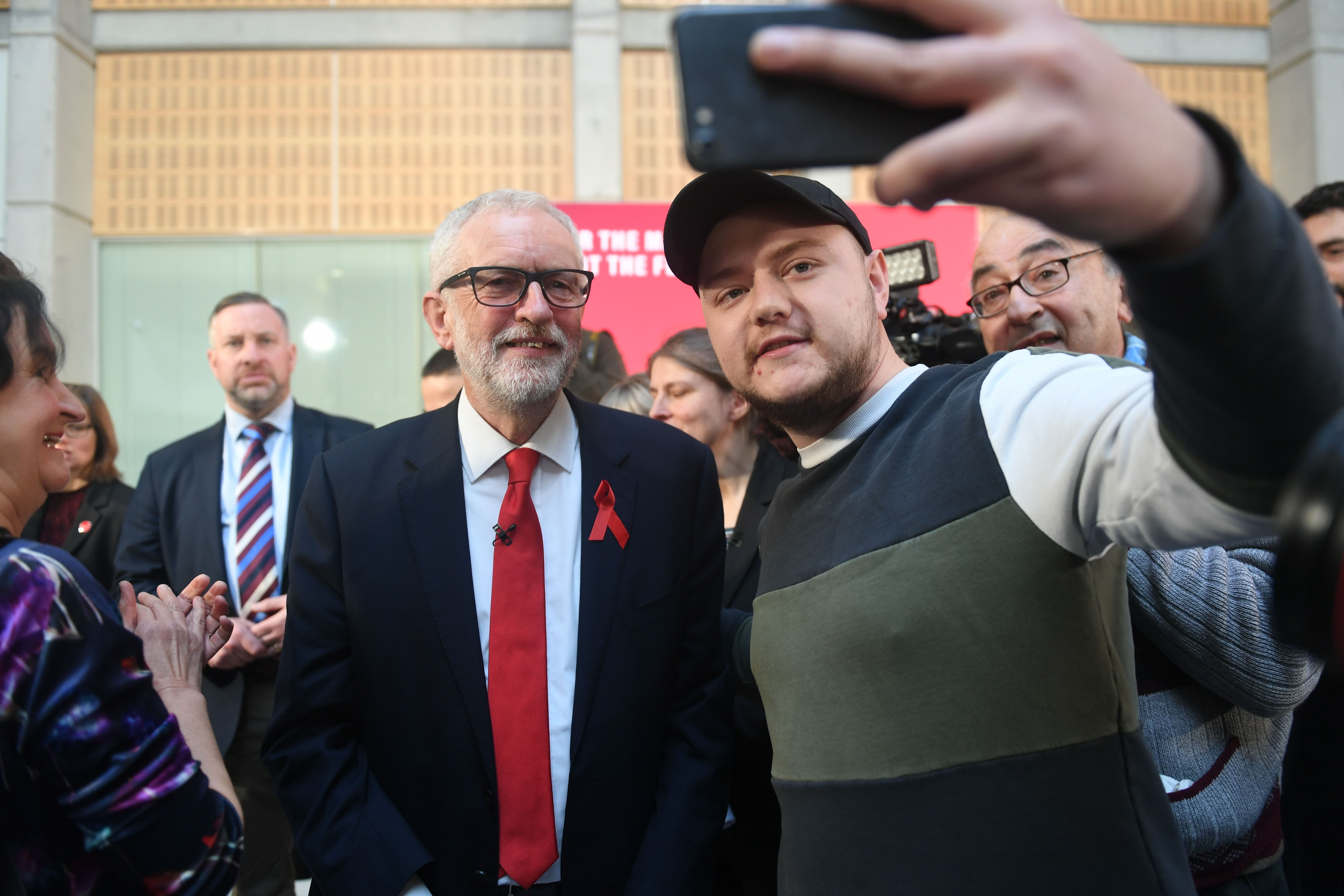 Labour leader Jeremy Corbyn takes a selfie with a supporter following a speech on international and foreign policy in York, while on the General Election campaign trail.