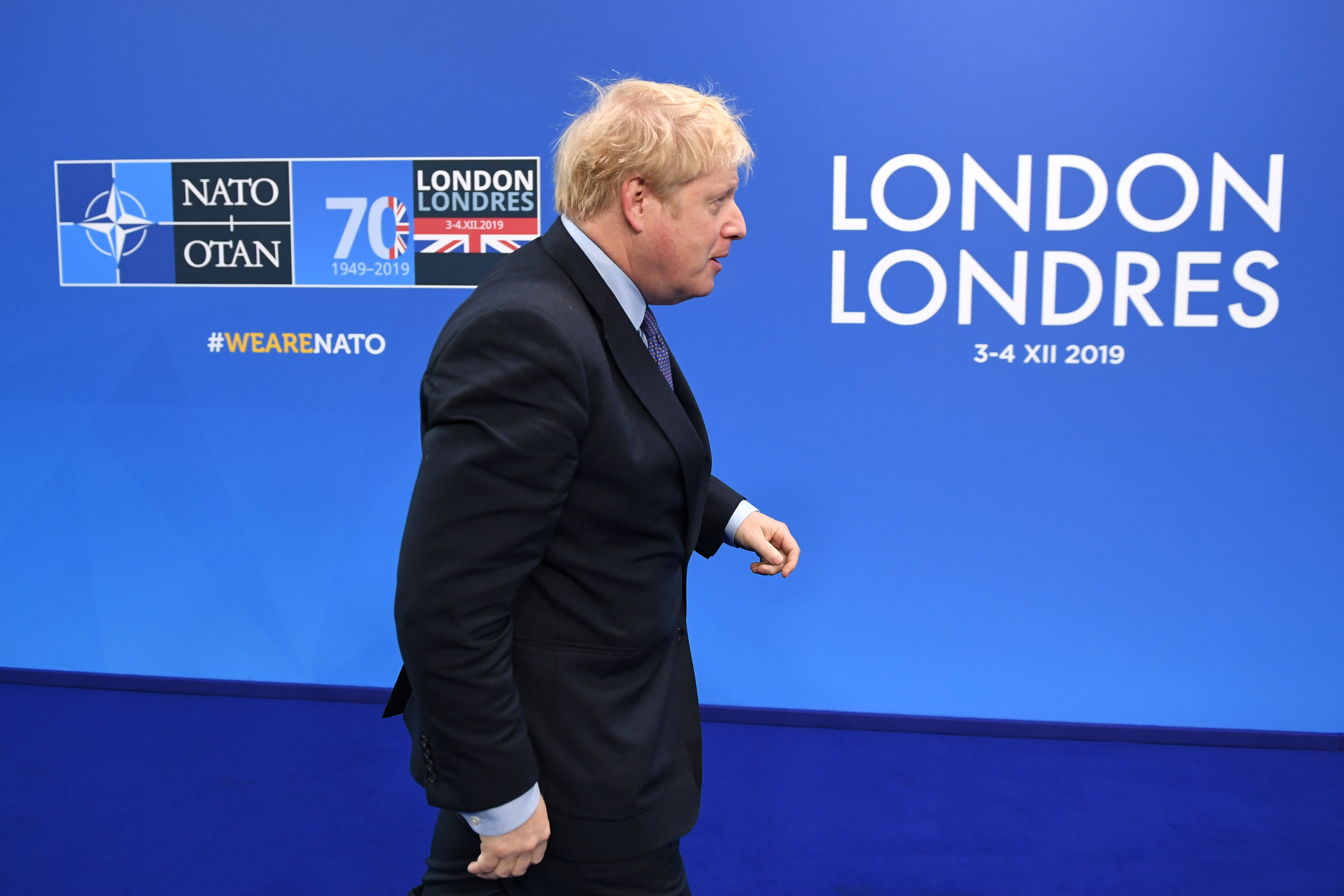 Prime Minister Boris Johnson arrives for the annual Nato heads of government summit at The Grove hotel in Watford, Hertfordshire.