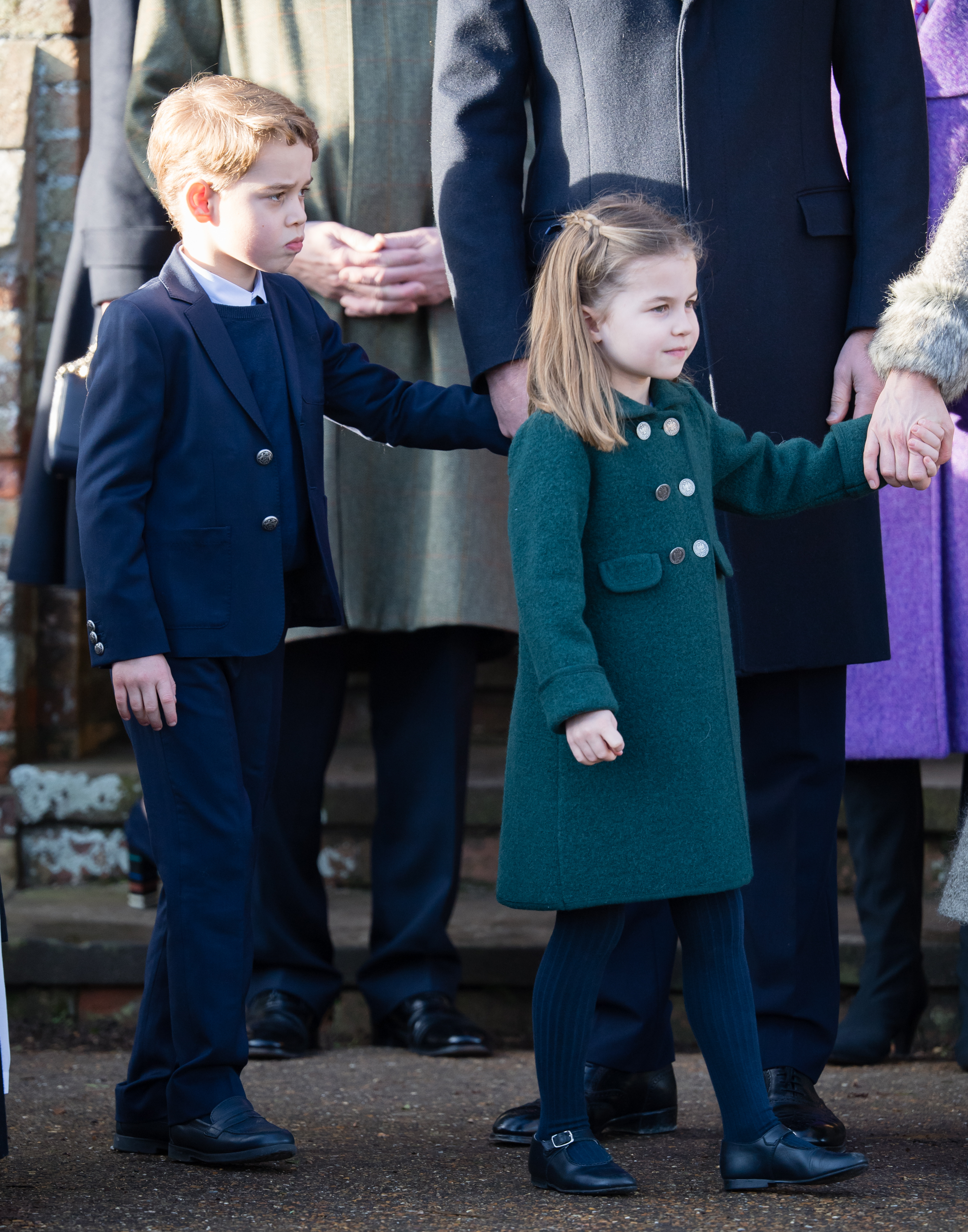 KING'S LYNN, ENGLAND - DECEMBER 25: Prince George of Cambridge and  Princess Charlotte of Cambridge attend the Christmas Day Church service at Church of St Mary Magdalene on the Sandringham estate on December 25, 2019 in King's Lynn, United Kingdom. (Photo by Pool/Samir Hussein/WireImage)