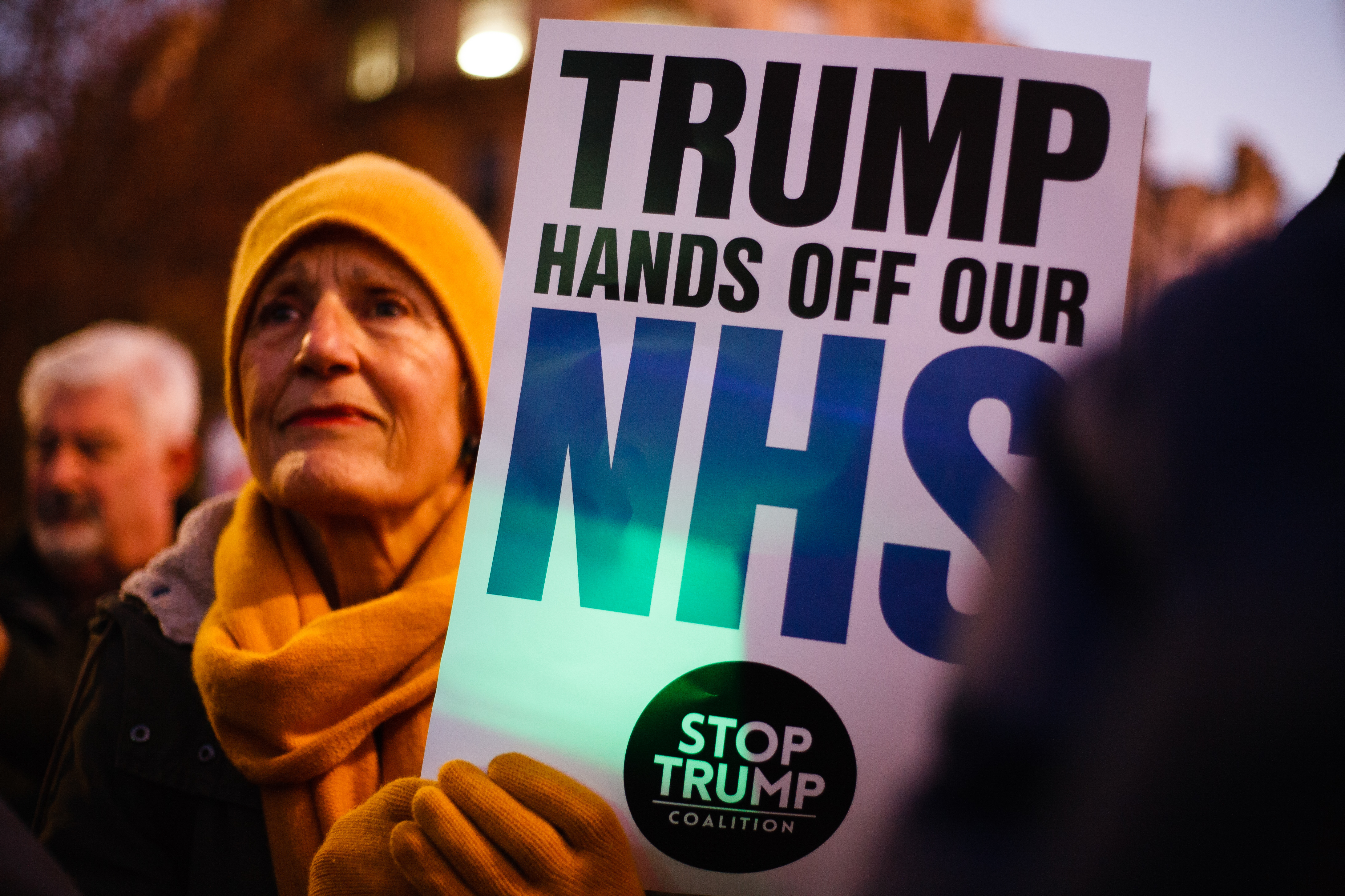 An activist holds a placard opposing any post-Brexit US market access to Britain's National Health Service (NHS) during the demonstration. President Trump arrived in the UK on a three-day visit last night, chiefly to attend the NATO summit in Watford. Activists protest against Trump�s visit in Trafalgar Square. (Photo by David Cliff / SOPA Images/Sipa USA)